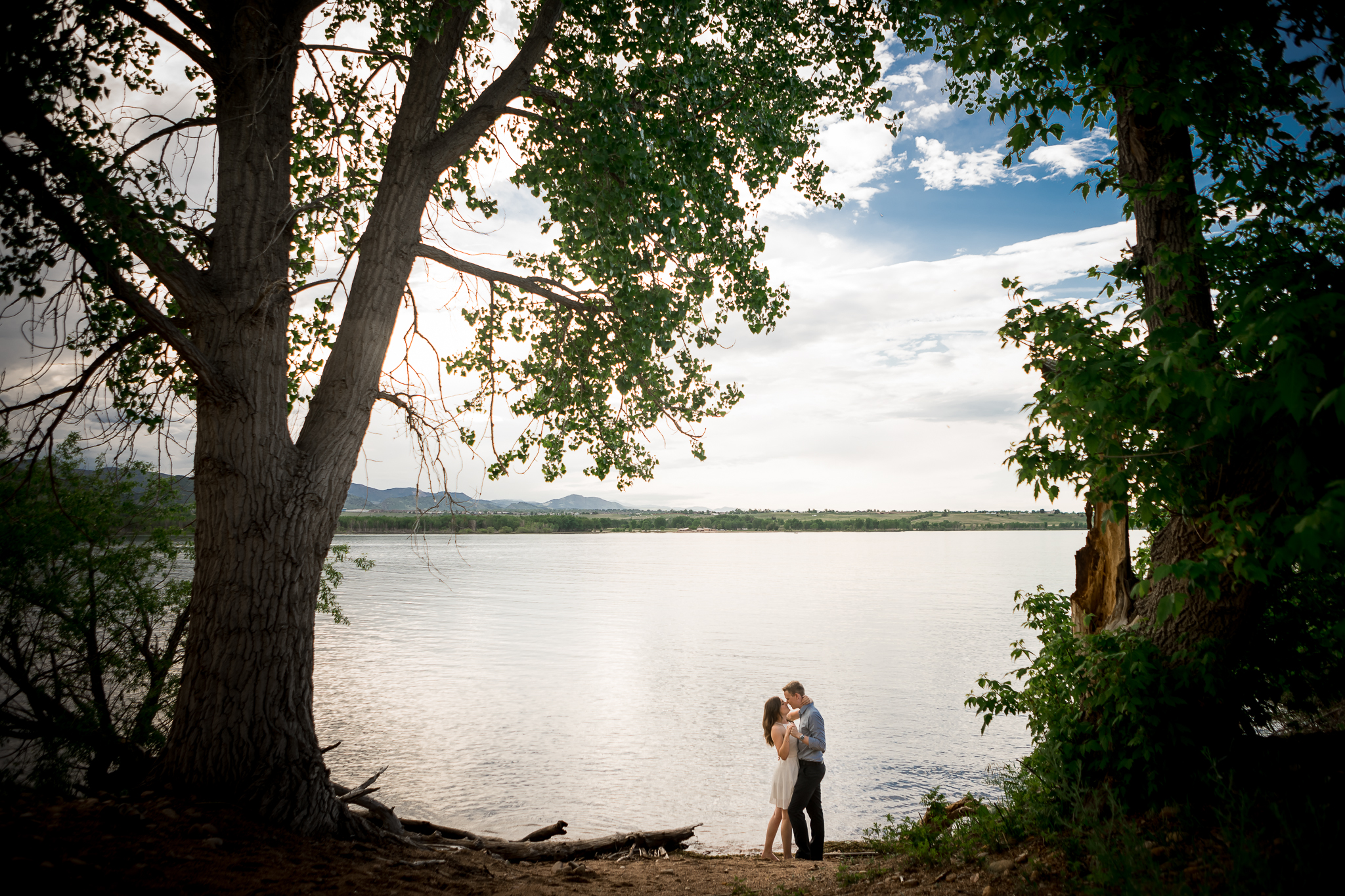This secluded spot by the water was Alex's choice for a surprise proposal a few months ago. It only seemed fitting to return here for their engagement session.