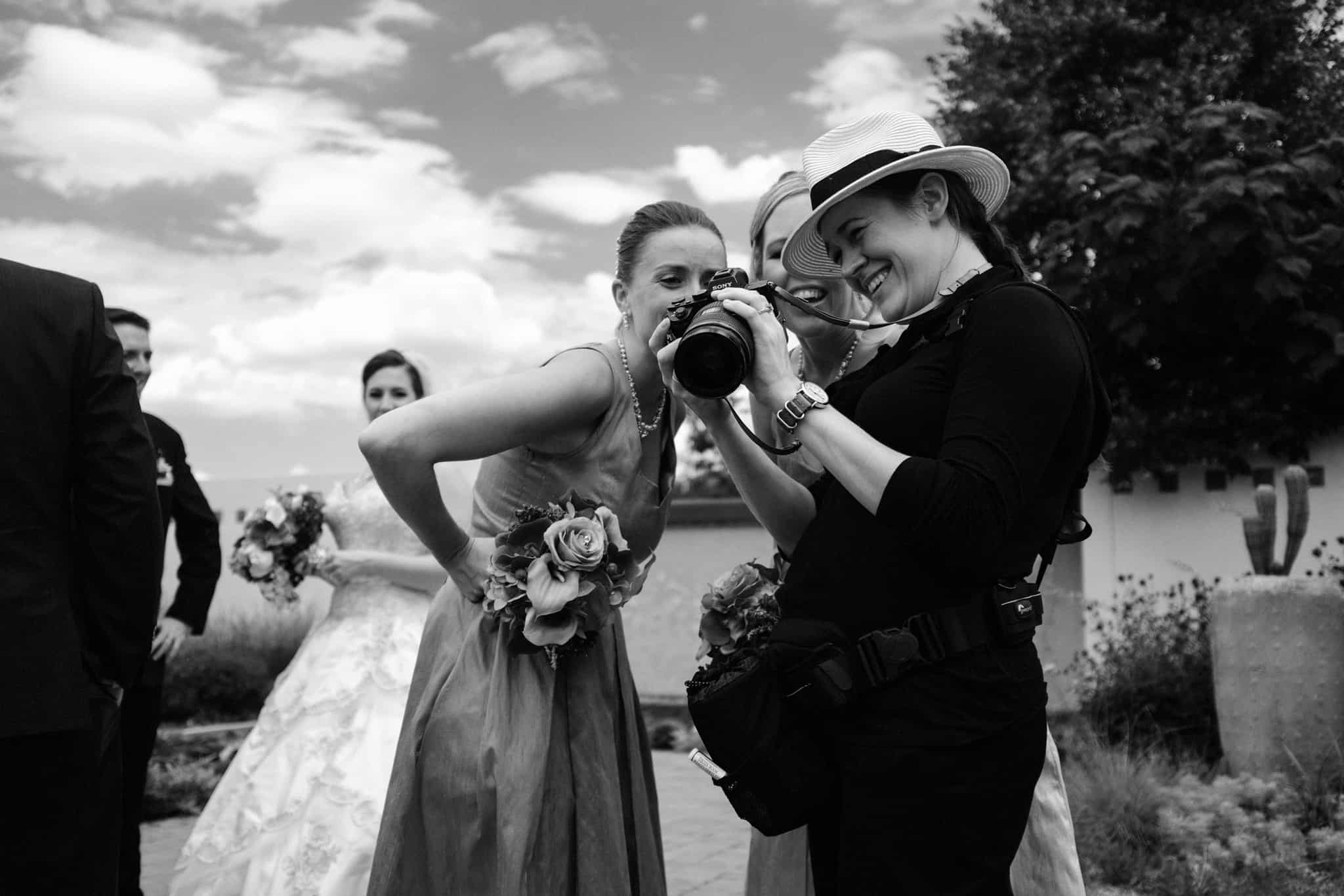 Me, sharing a favorite capture with two bridesmaids in Denver, CO
