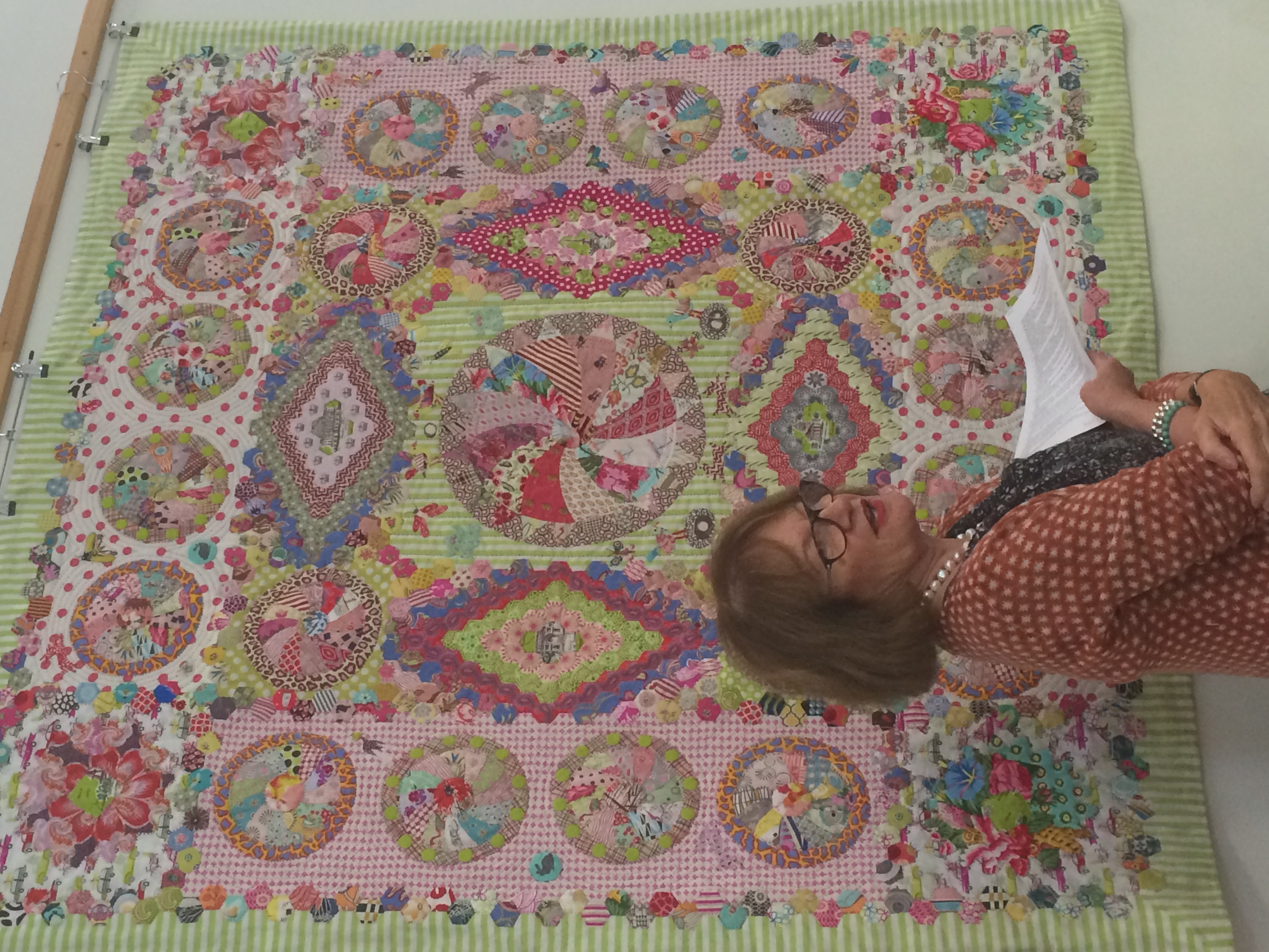 The 'Going Green' quilt, and Margaret taking us through the details.