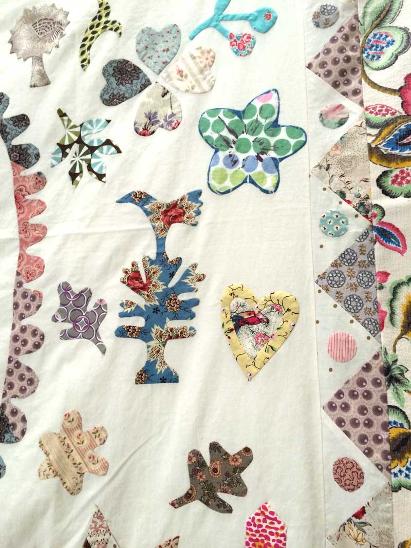 A close up of a crib quilt.