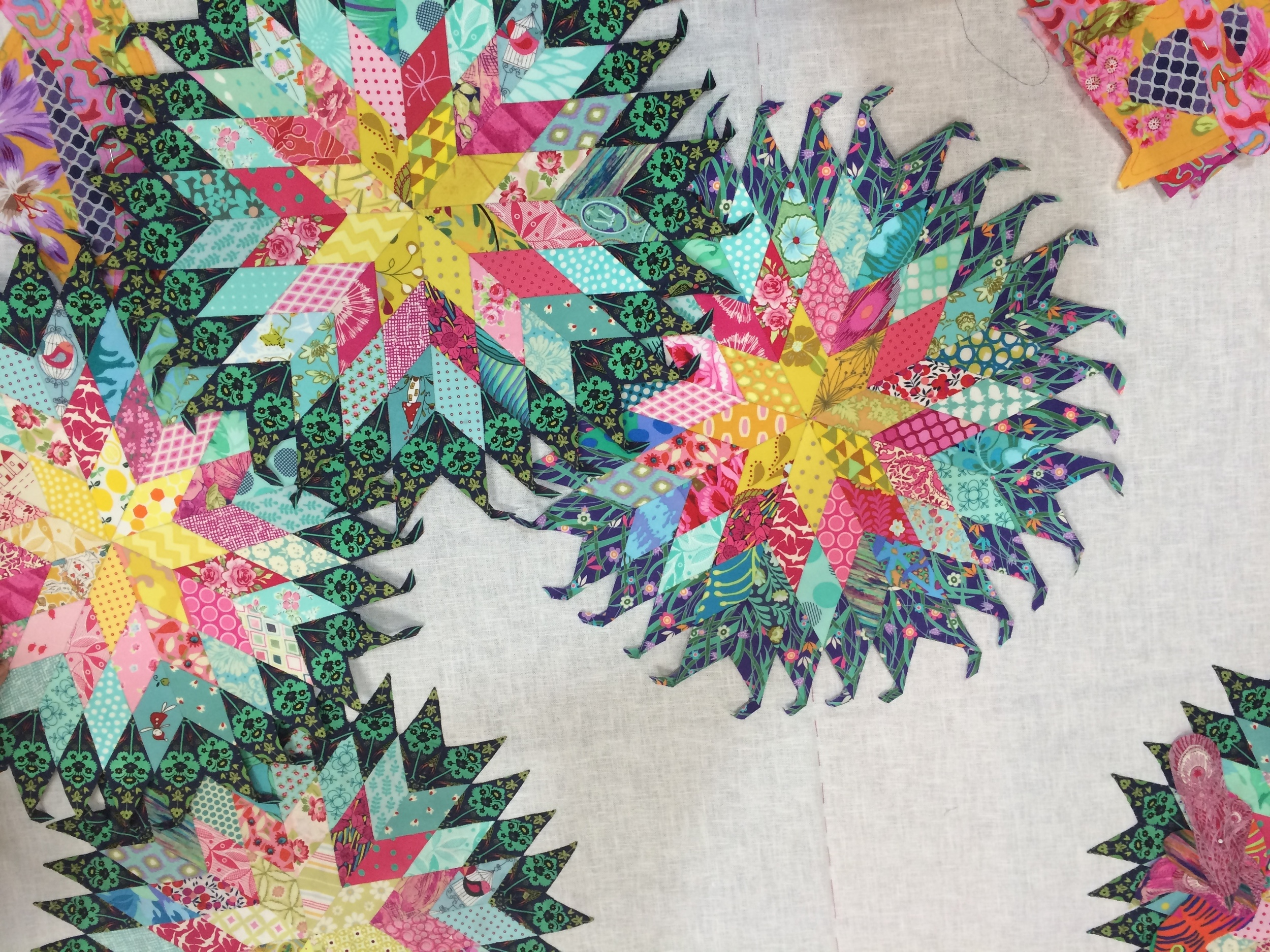 Julie's paper pieced stars need to be positioned.