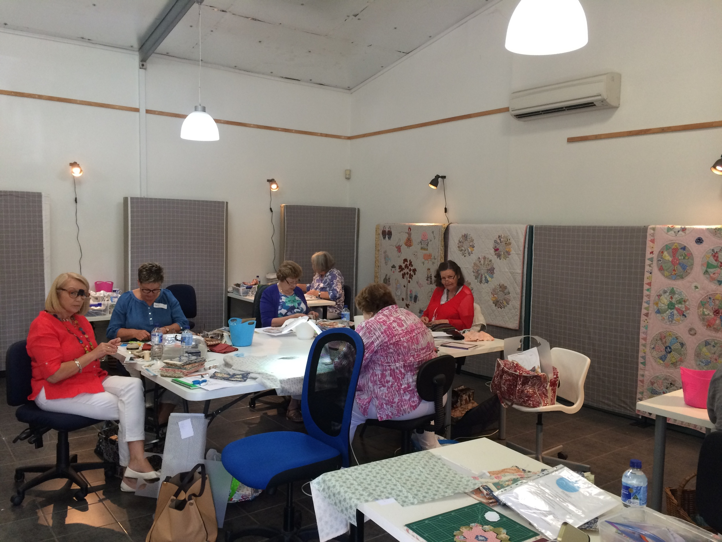 Busily stitching in the well lit studio.