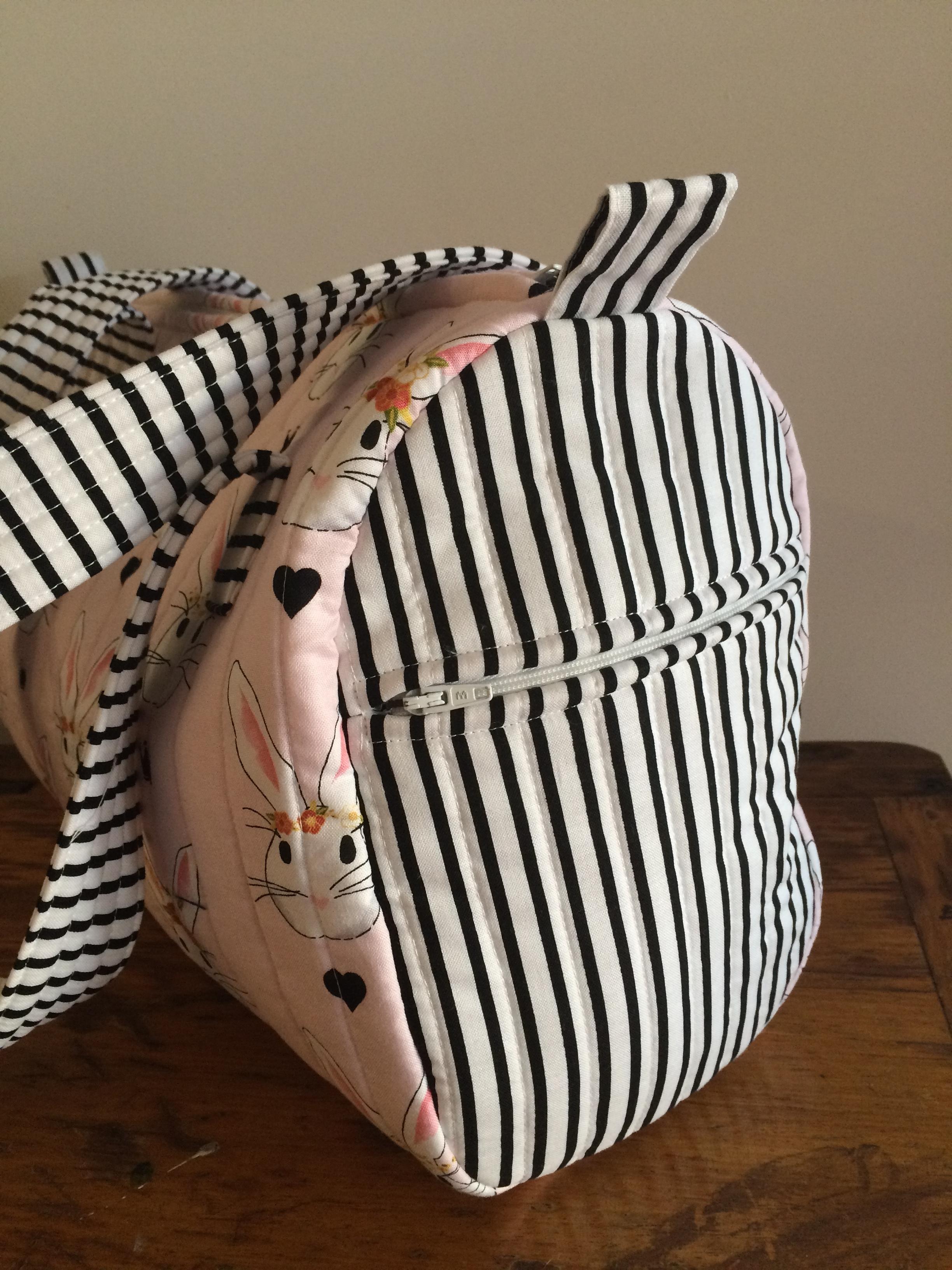 A zipped bag end.
