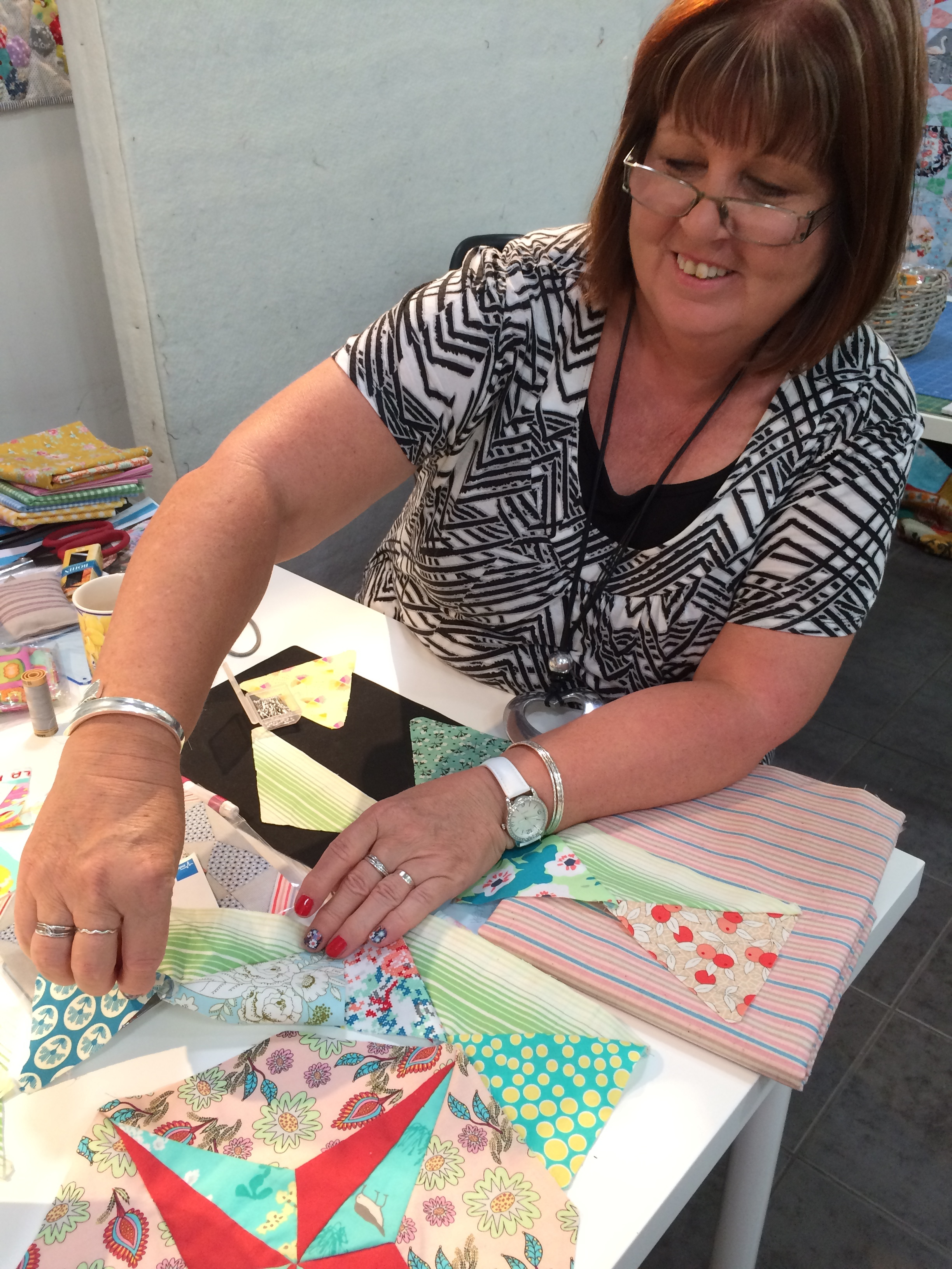 Sue and her Mayfair block that includes beautiful Art Gallery and Kathy Doughty fabrics. Sue's nails almost match her fabric choices, so I wonder then if choosing her fabric was a conscious choice or does she naturally tend to choose those colours?