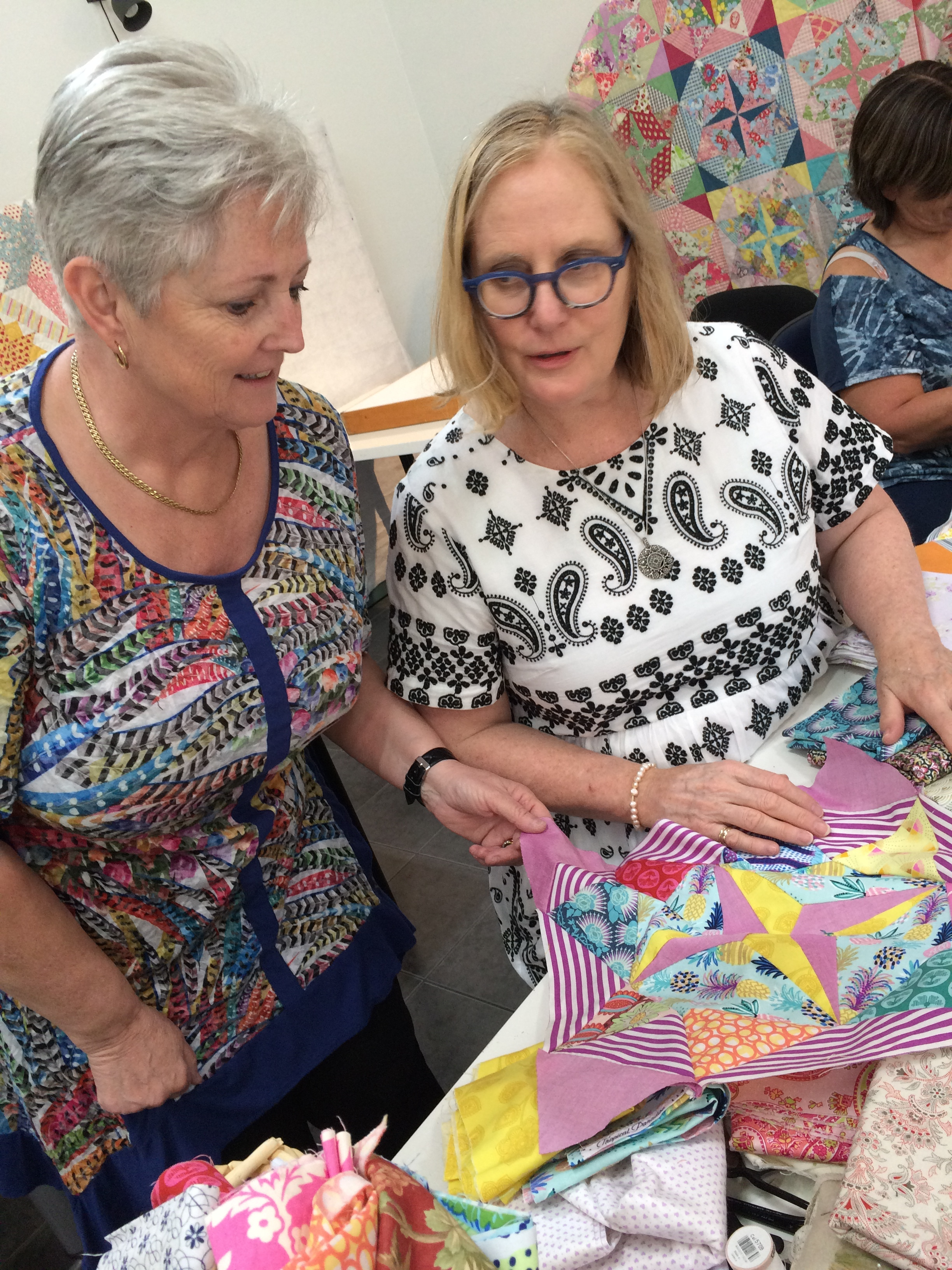 Here Judy (on the right) is helping Sue exclude some fabric choices. Sue's Mayfair block has some Victoria Finlay Wolfe fabric and some Anna Maria Horner too.