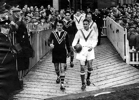 Willie and Clive Churchill lead the teams out for the first 1952 test match at Headingley.