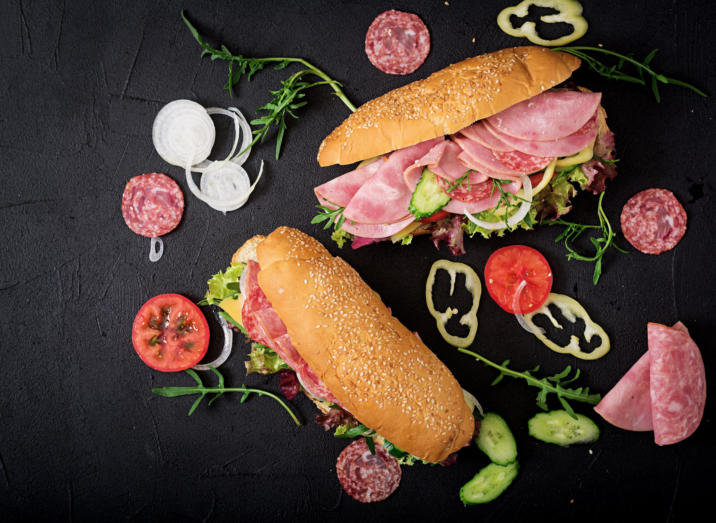 big-sandwich-with-ham-salami-tomato-cucumber-and-PYY8RF7.jpg
