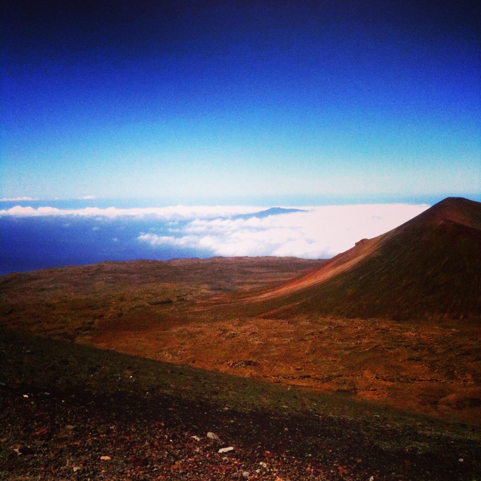 Looking at the top of Hualalai while heading up Mauna Kea.