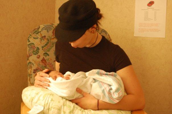 Regan Smith mistakes baby for large burrito, prepares to bite. Photo Courtesy of Regan Smith.
