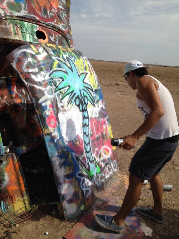 Yatika at Cadillac ranch Amarillo, TX making a mark
