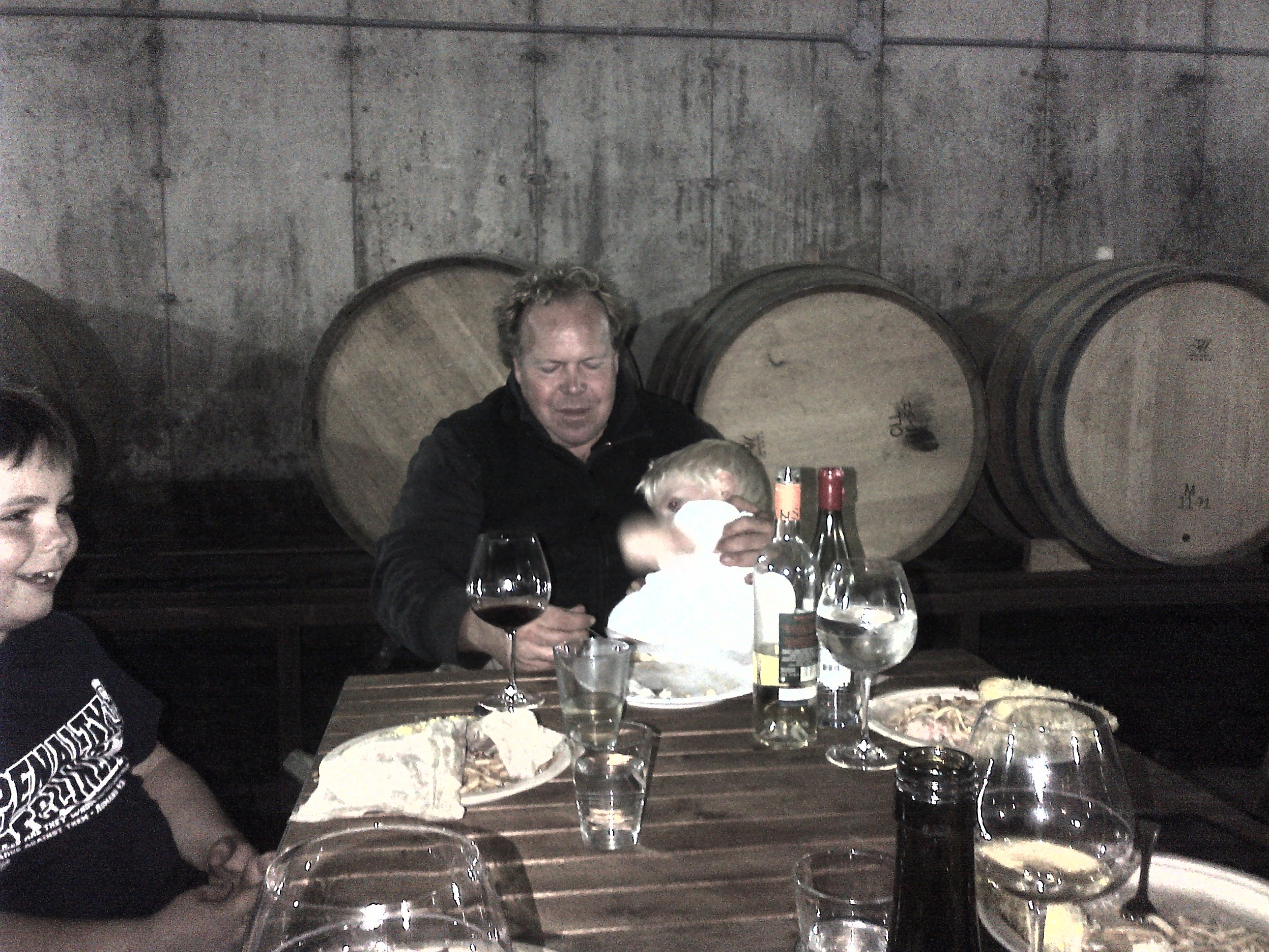 Norm with his two sons at dinner in the barrel chamber.