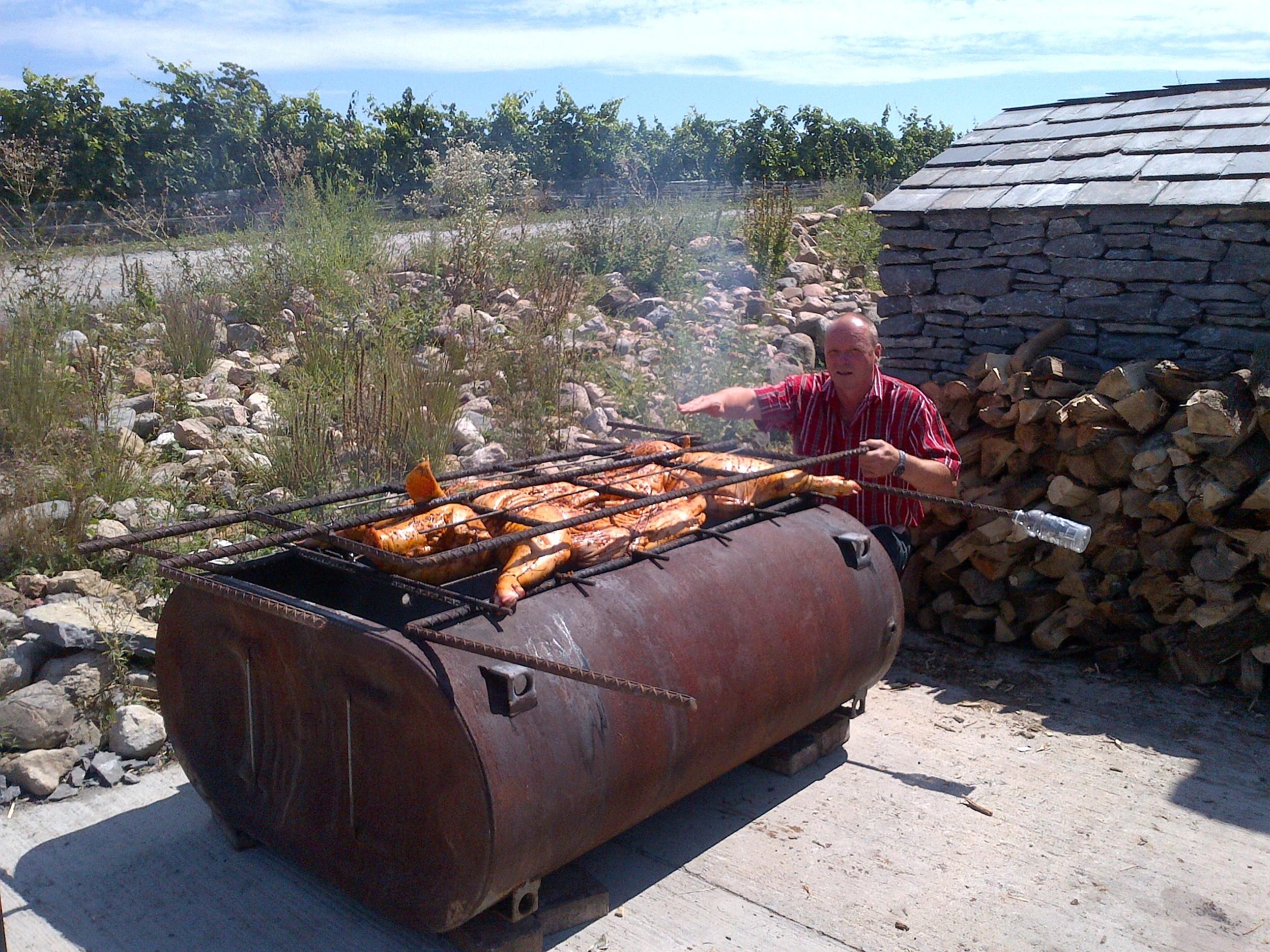Johannes working on the pig roast...