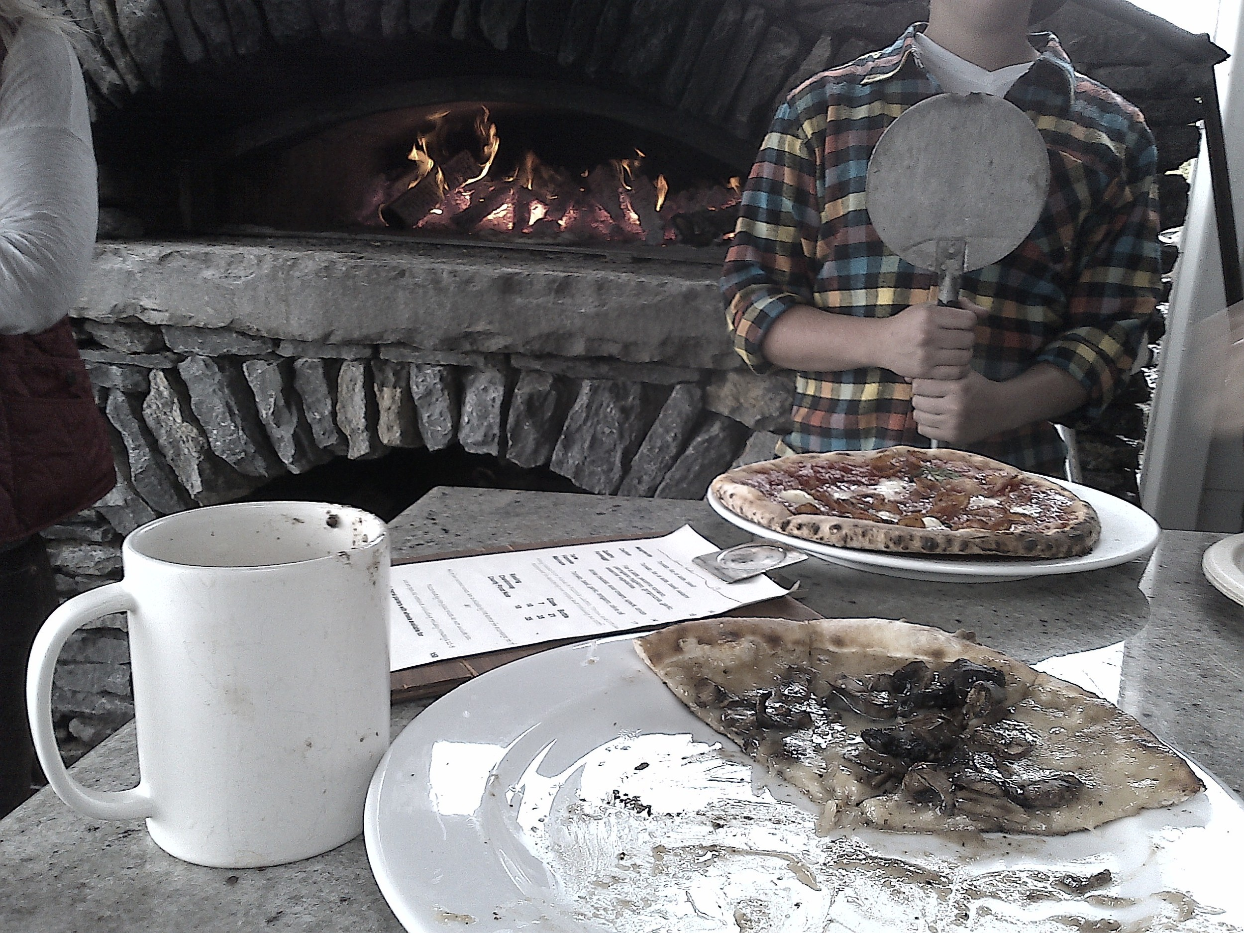 Coffee and pizza from the woodfire pizza oven.