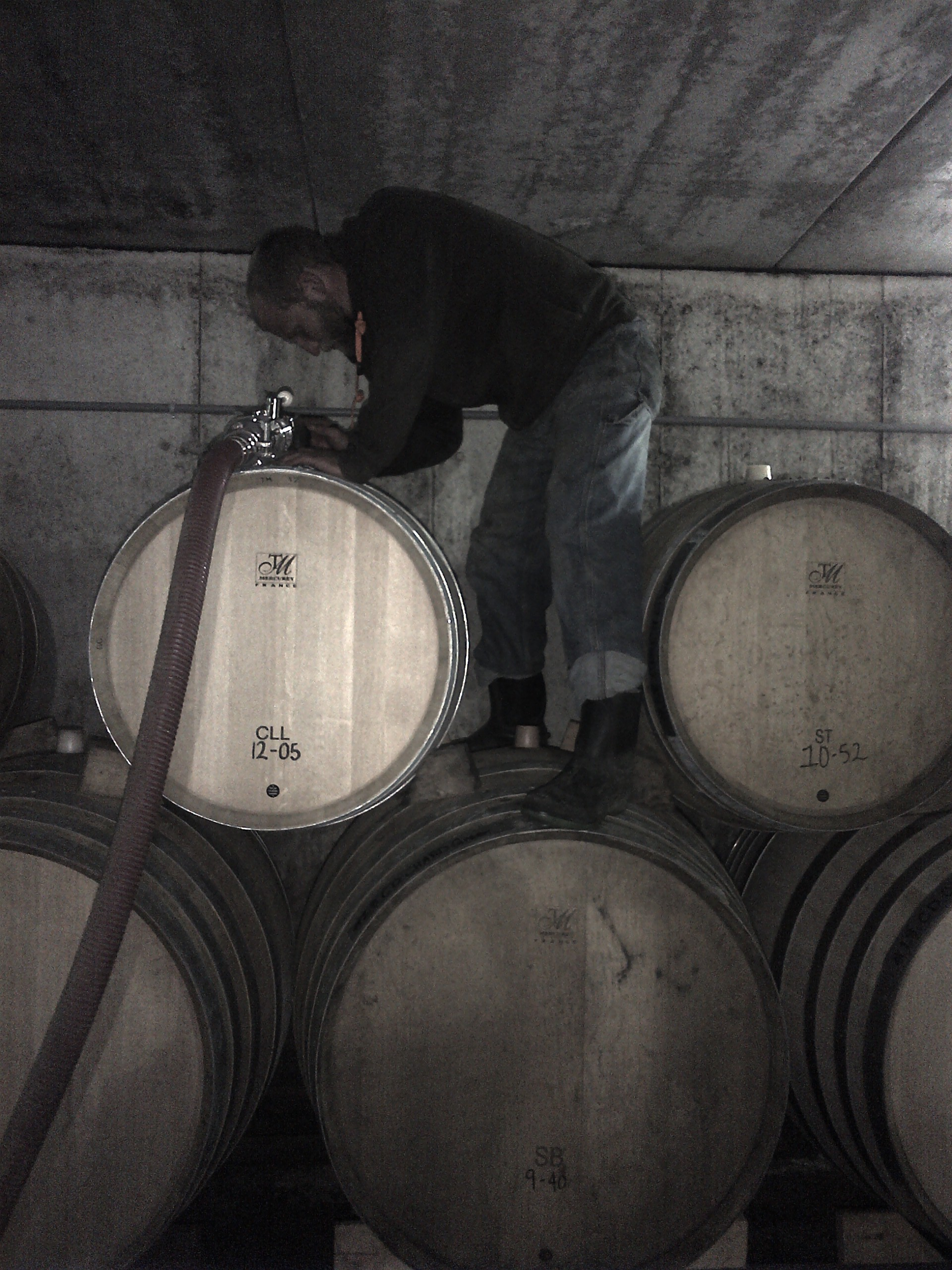 Assistant winemaker Richard Charnock filling barrels of Chardonnay.