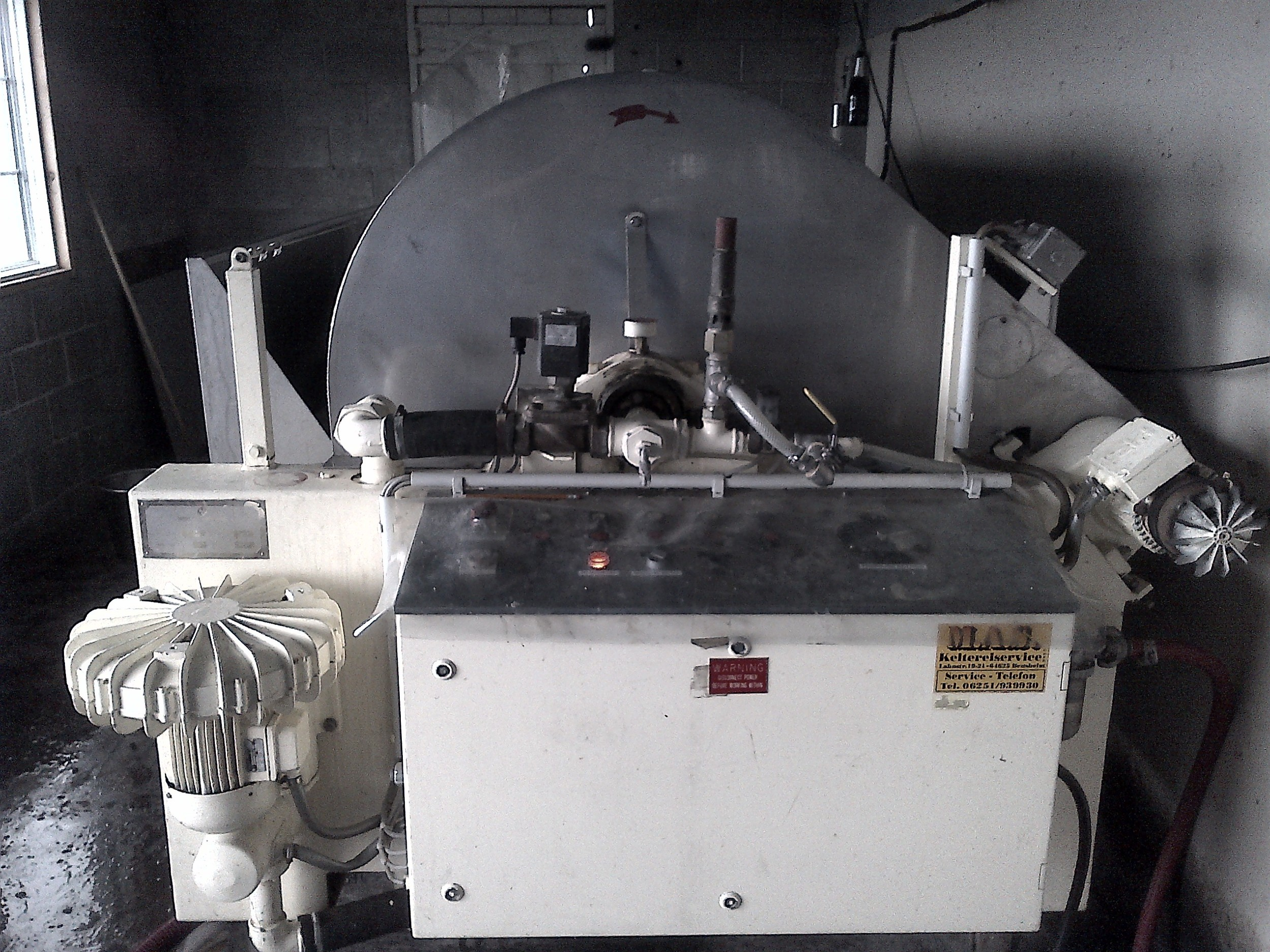 Hinterland's horizontal tank press uses an pneumatic airbag to gently apply pressure to the grapes and continuously squeeze the juice out of the skins.
