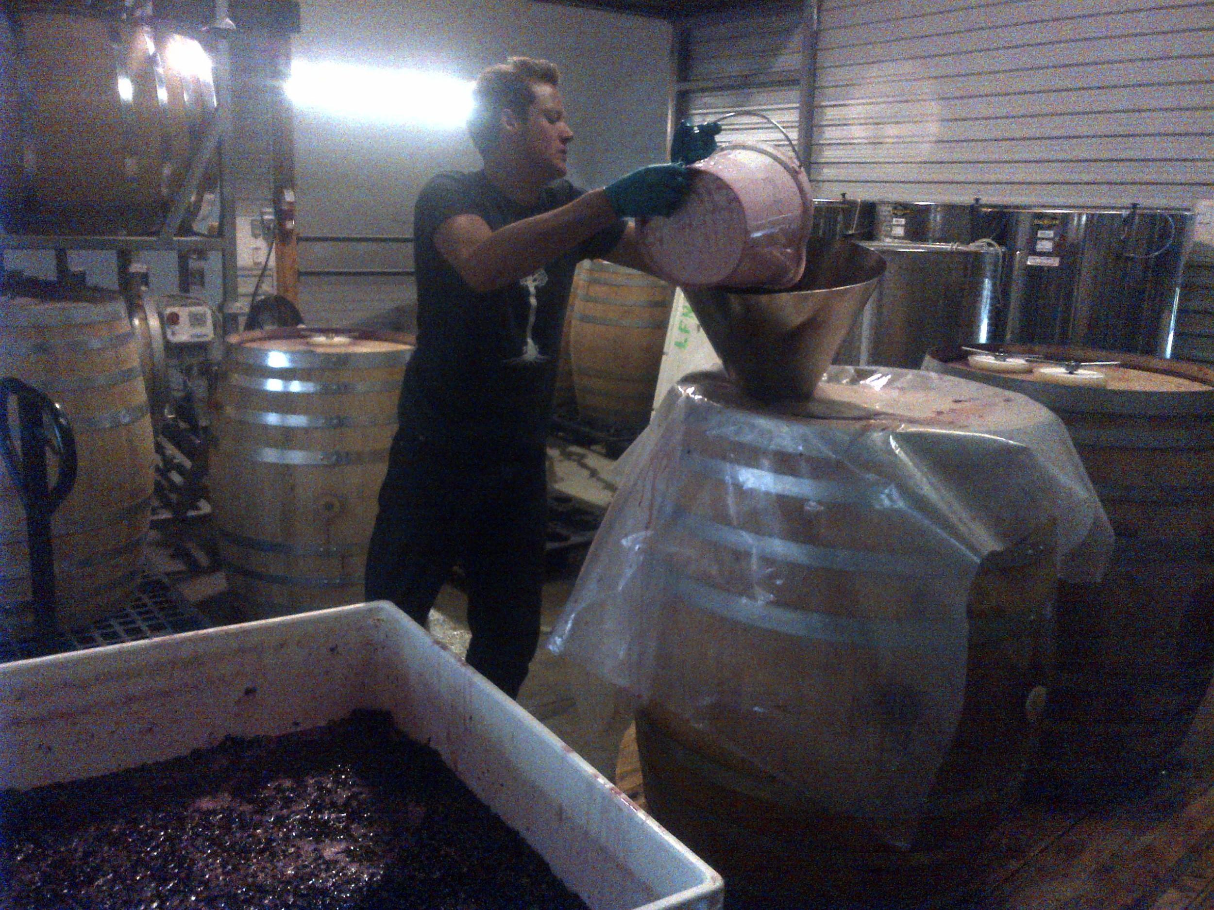 Kalen, David's son loading barrels.