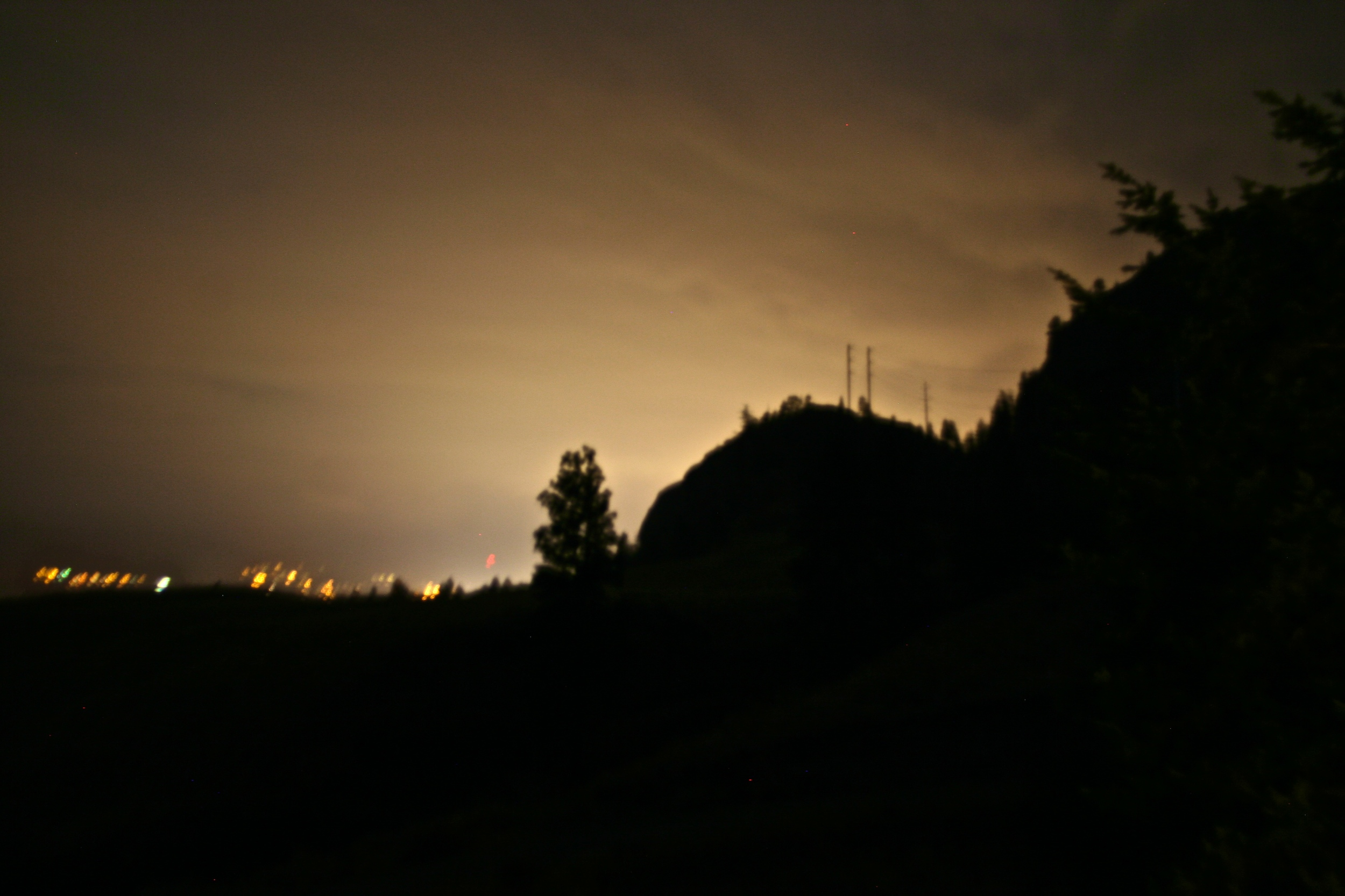 The evening lights of Penticton shining over the Bluffs at the winery.