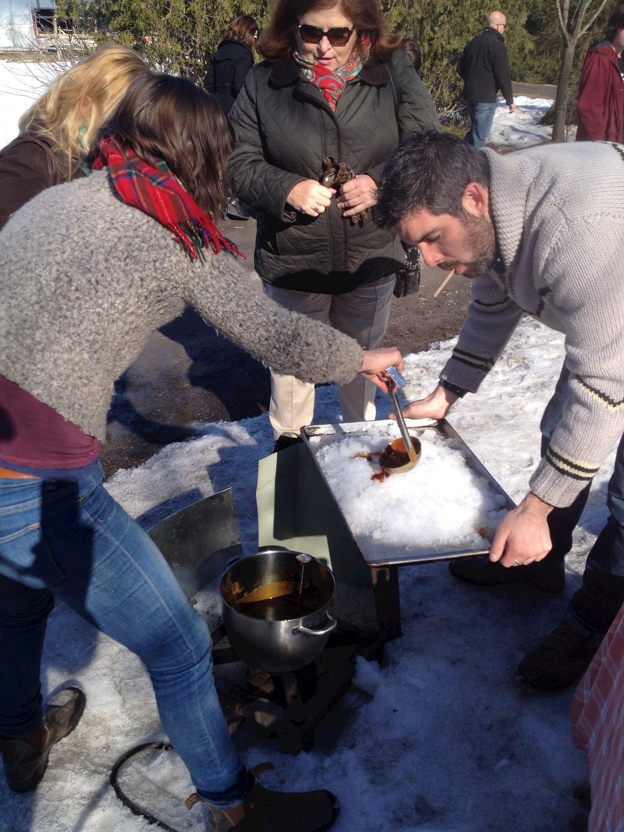La Ferme ÄLska  owner  Genevieve   @alskafarm  and Andrew Gilbotawicz testing out her fresh maple taffy.