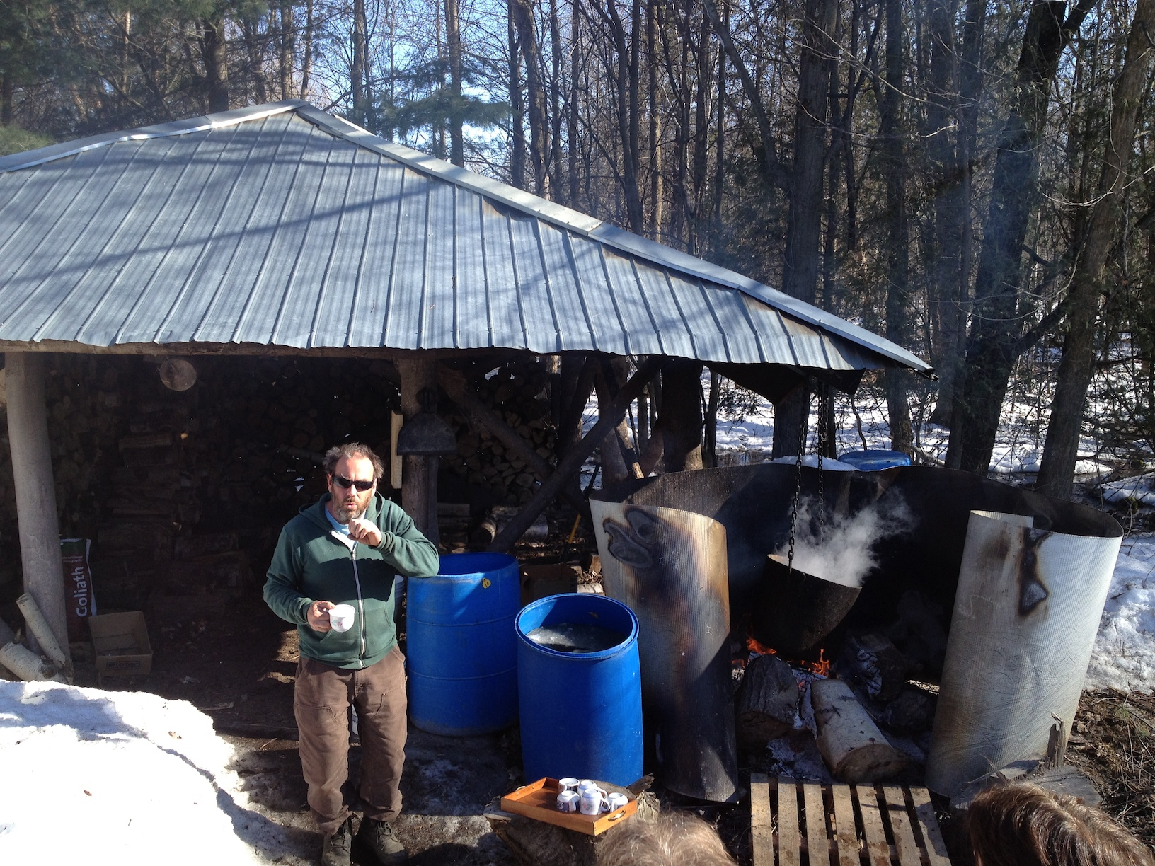 Farm owner Ian Walker explaining the process of Maple syrup production beside his cauldron of boiling sap.