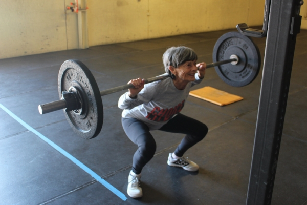 77 year old Judy smiling her way through her back squat session!