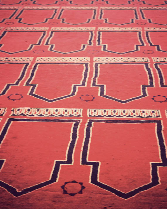 Large prayer carpet covering the floor