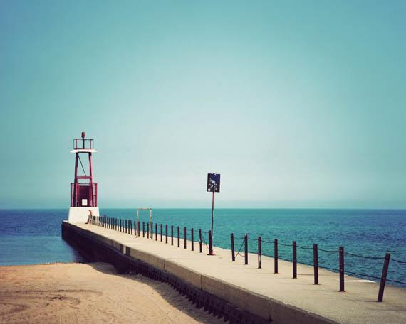 A lone beachgoer enjoying the beautiful blues of Lake Michigan