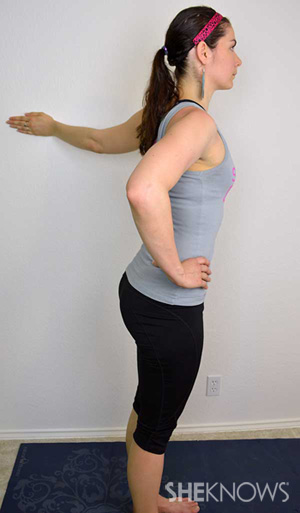 5-yoga-poses-to-help-you-release-stress-wall-shoulder-pose.jpg