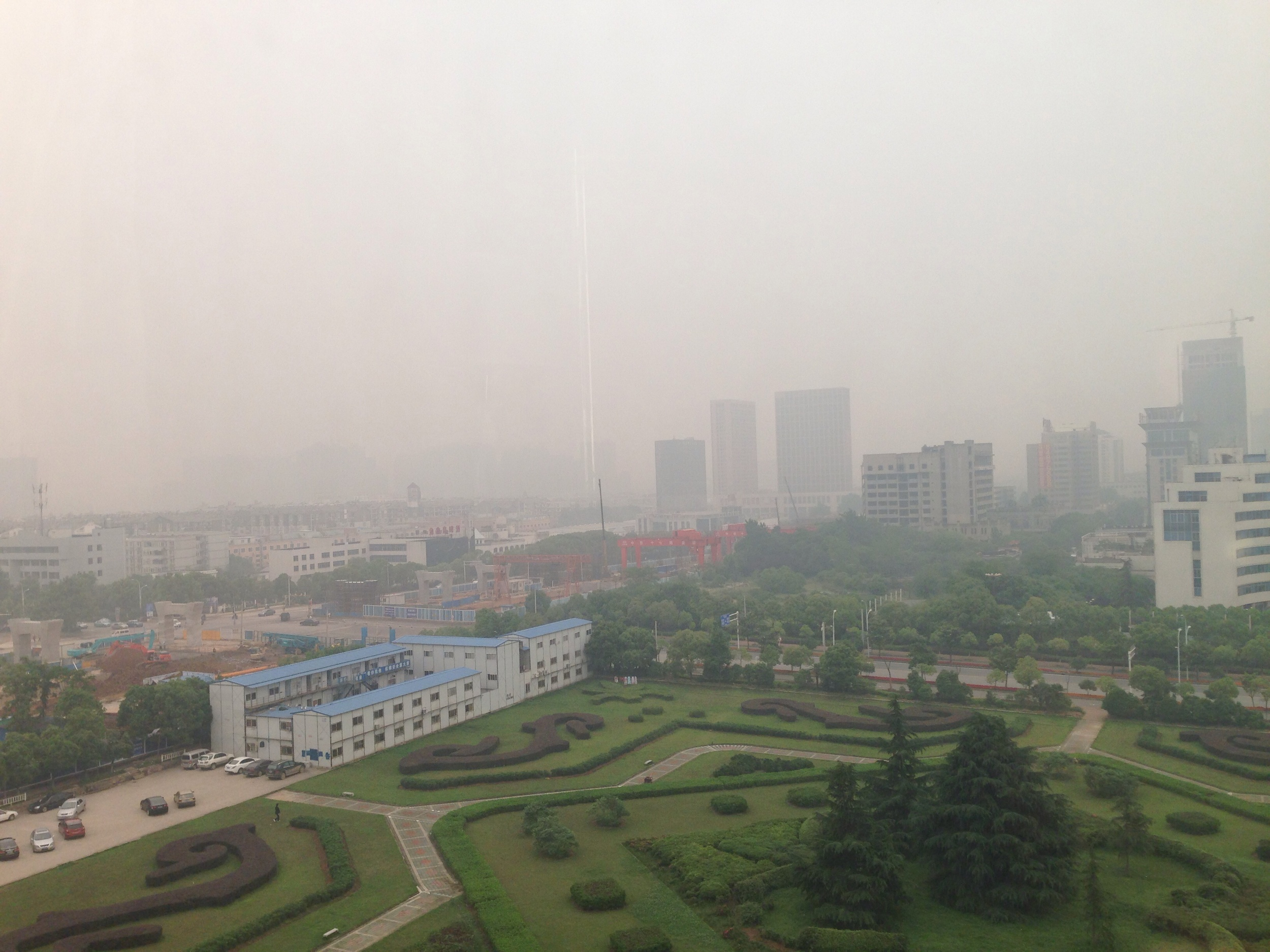 Day one around noon. There are many more buildings hiding in that haze.