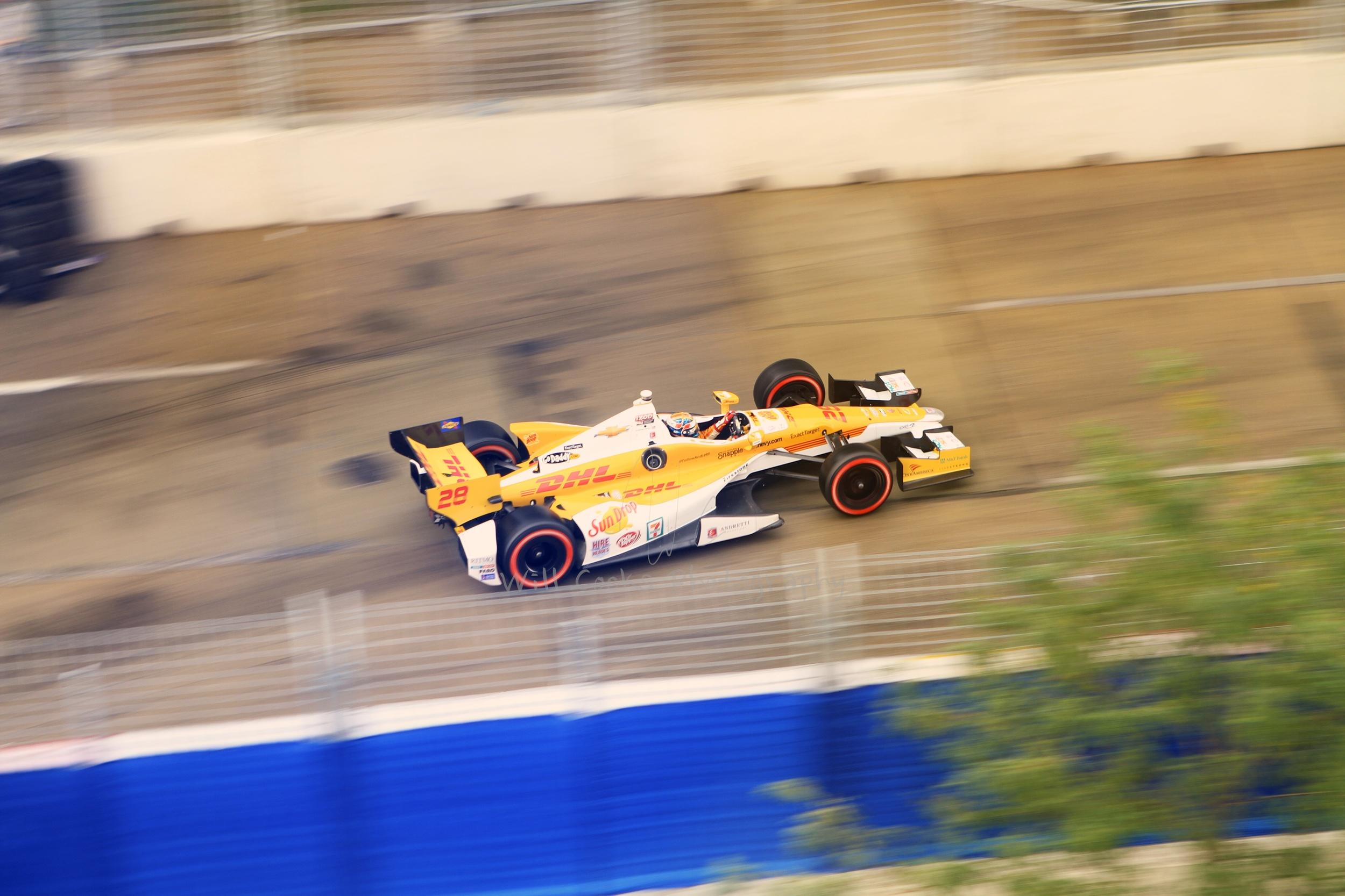 Ryan Hunter-Reay speeds down Pratt St after Turn 12 in Baltimore, MD