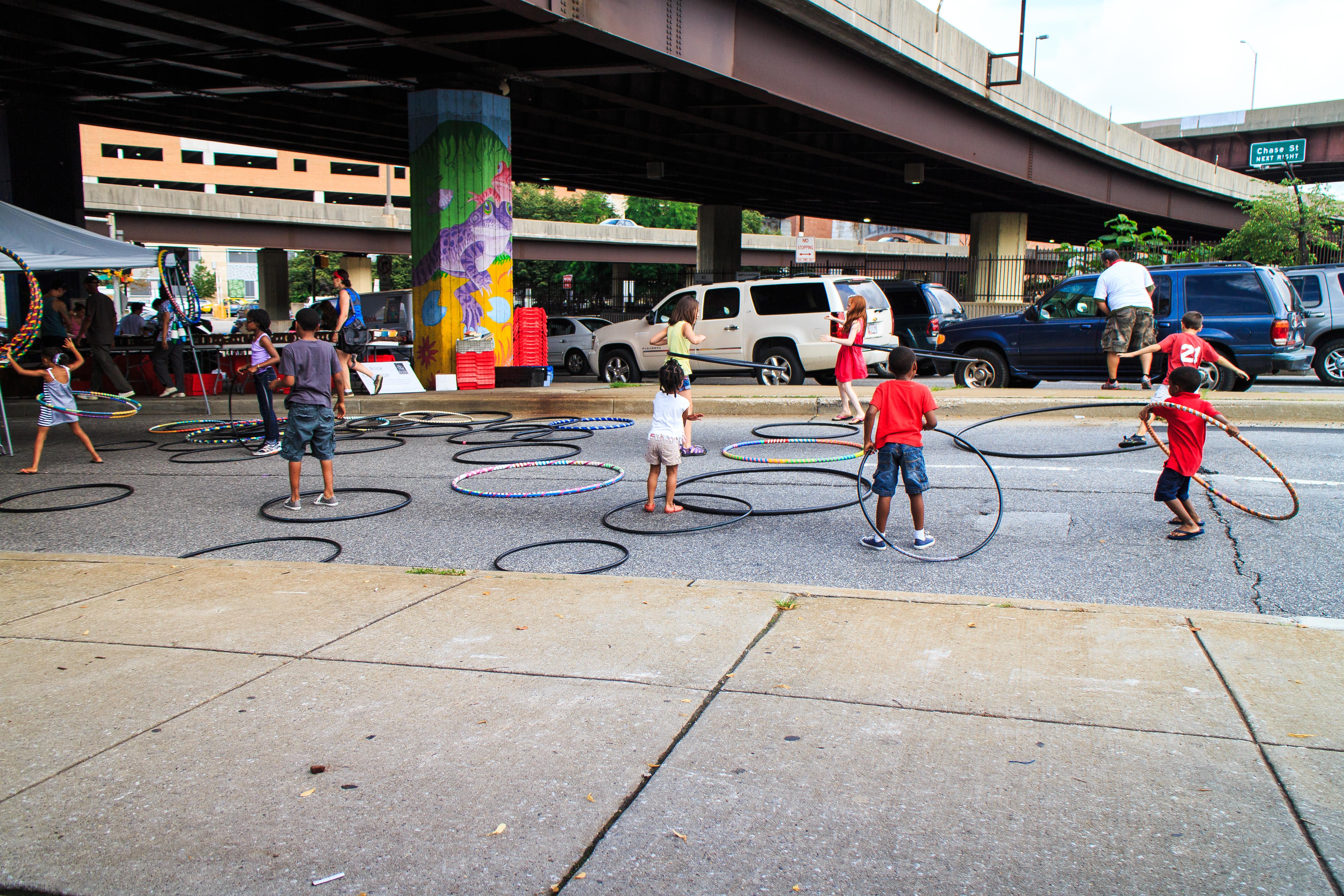 Kids and Hula Hoops at the market.
