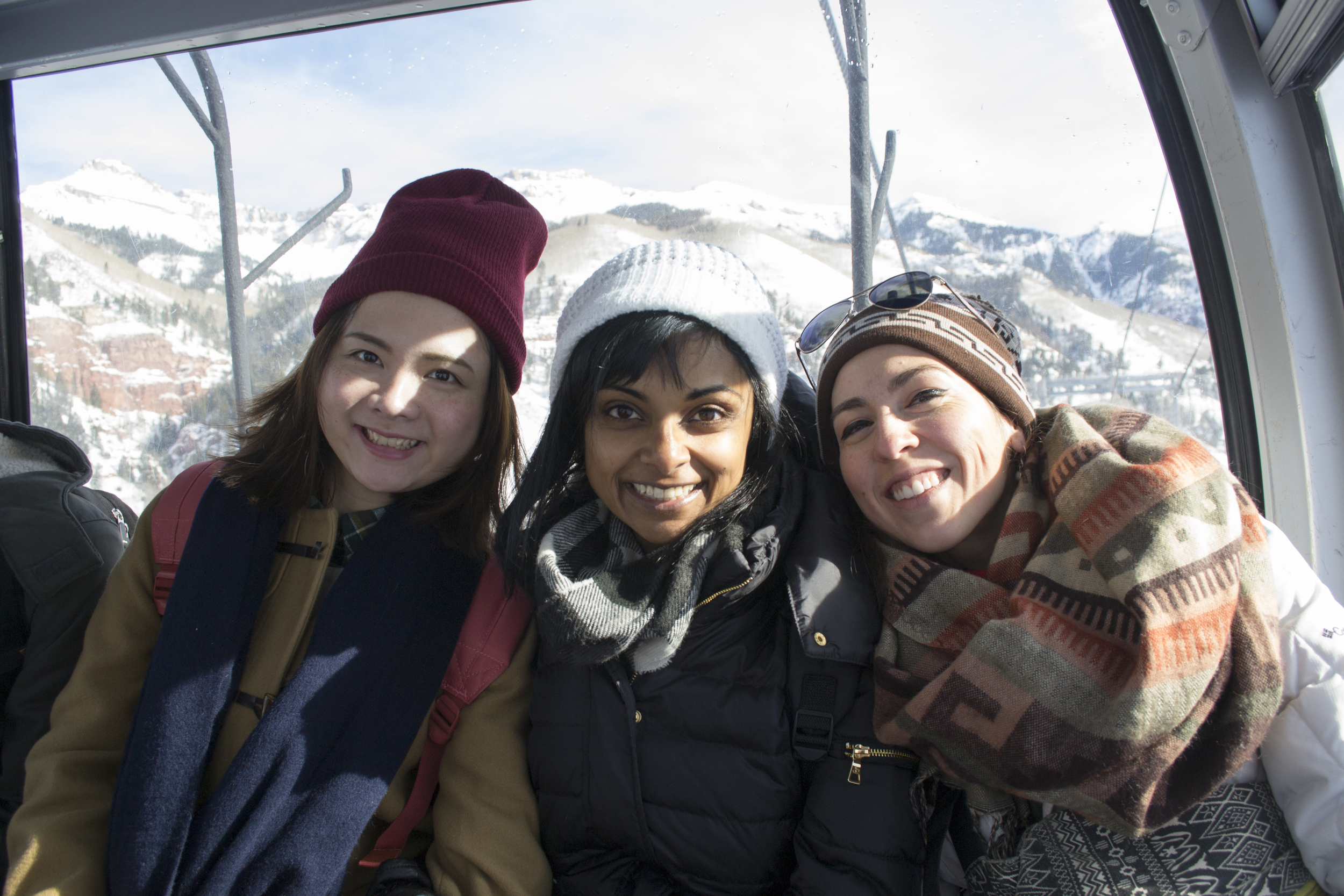 Yinfan, Anuja, and Lindsay ride the gondola from Telluride to Mountain Villiage.