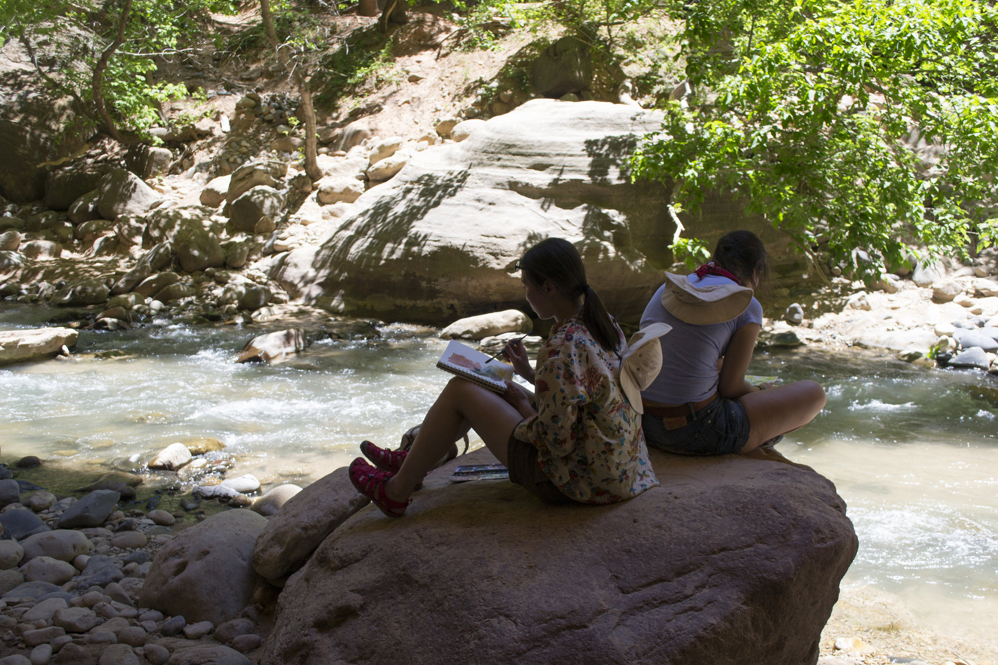 Artists take a break to sketch in The Narrows.