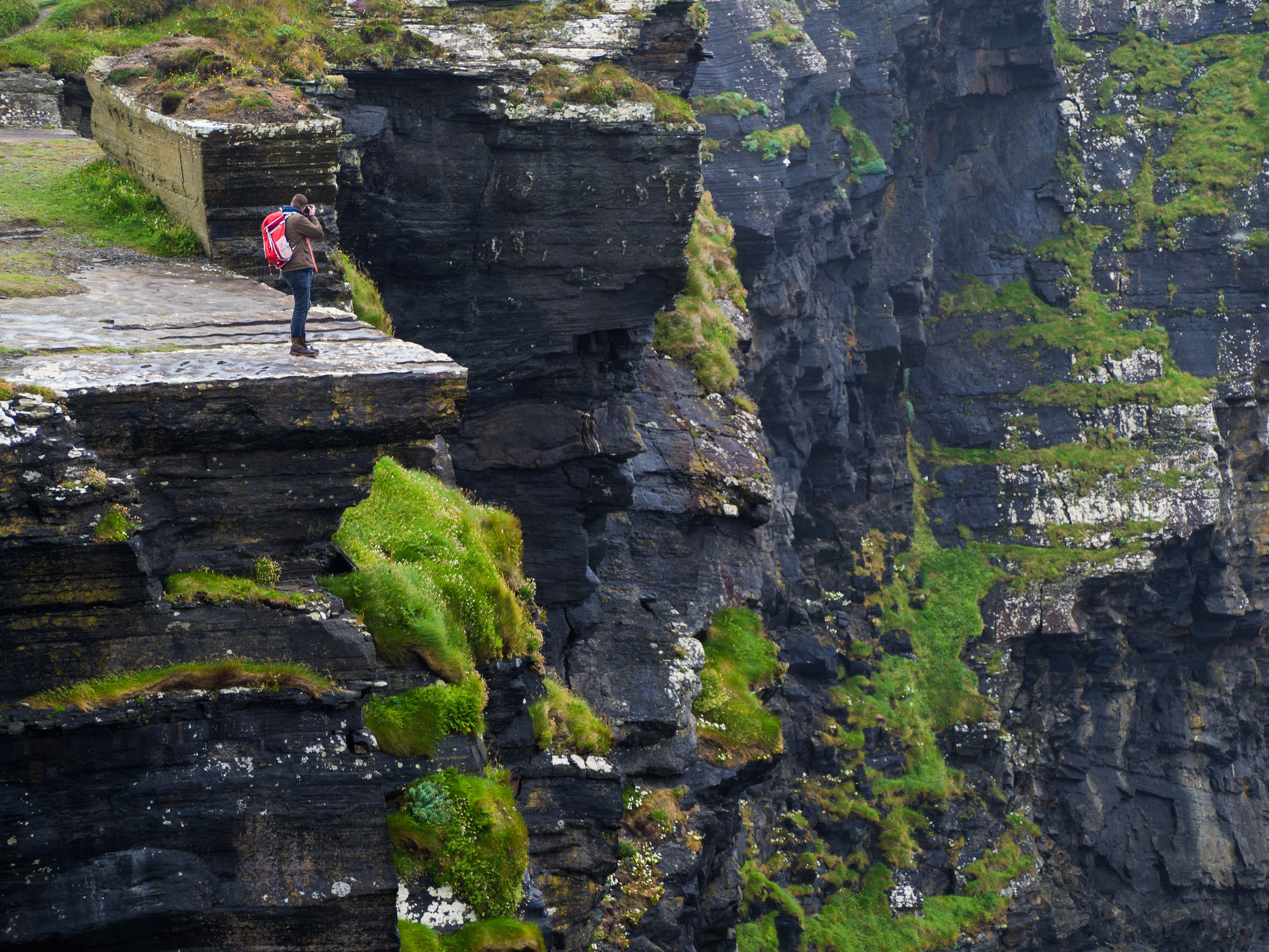 Chris Hajny photographs the Cliffs of Moher from one of the bluffs. Photo by Jesse Riggle.