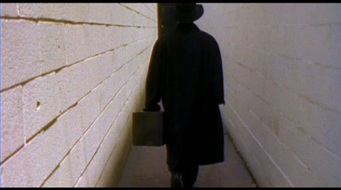 The man in black fled across the hallway, and the kickboxer followed.