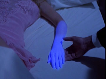 Your arm is glowing blue!  There must be orcs nearby!
