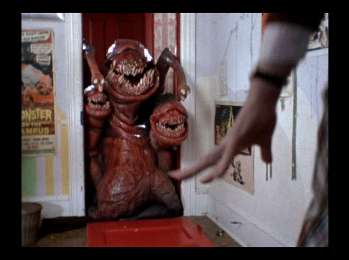 What was that, M. Night? Aliens can't get through a simple wooden door? WATCH ME!
