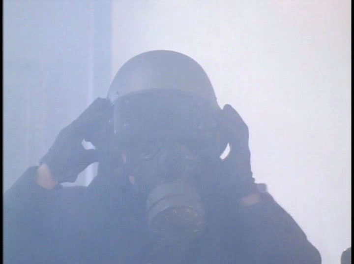 Yes, that is a gigantic VR helmet over a gas mask, in a smoke filled room.  Fuck visibility.