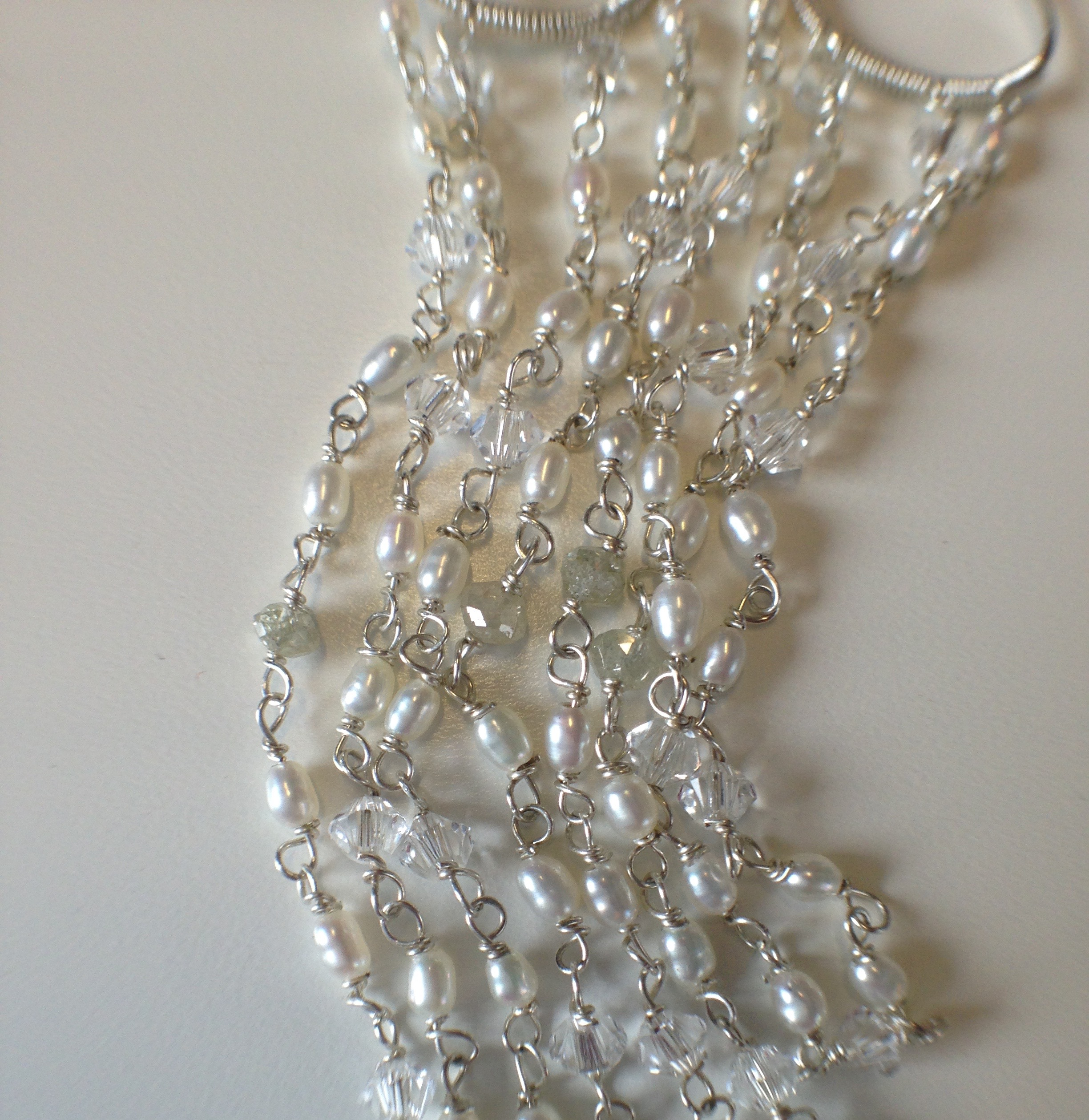 Detailing of Sara's earrings.  Pearls, Swarovski, and diamond