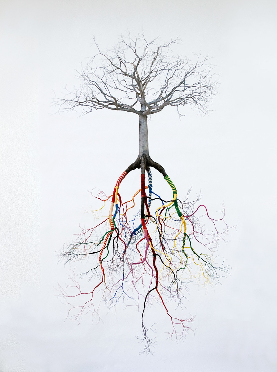 """Jorge Mayet A todos mis santos"""" (2008), paper, wire, acrylics and yarn"""