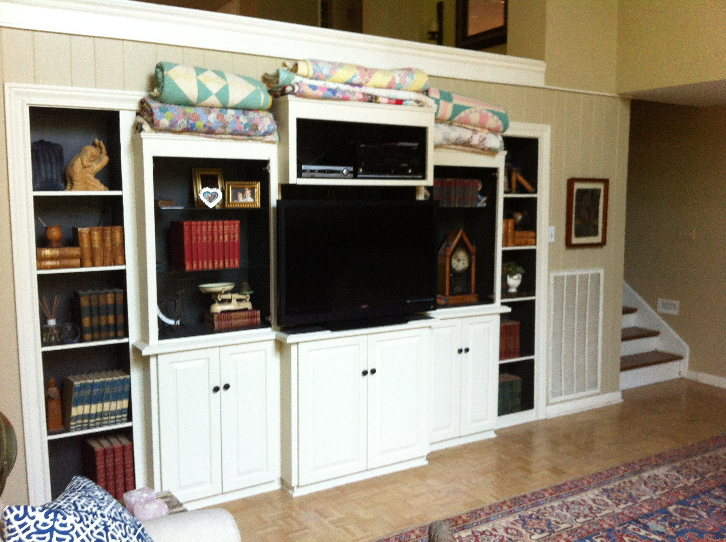 the living room cabinet (minus the glass doors) in it's new home in the den