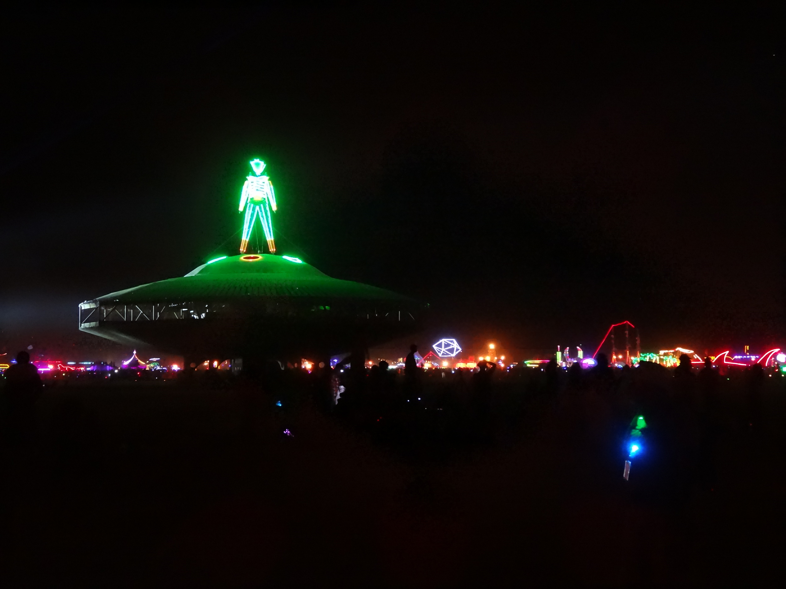 The Man stands proudly atop his pedestal on Saturday night.  The ring of camps is always a glowing spectacle in the dark of night.