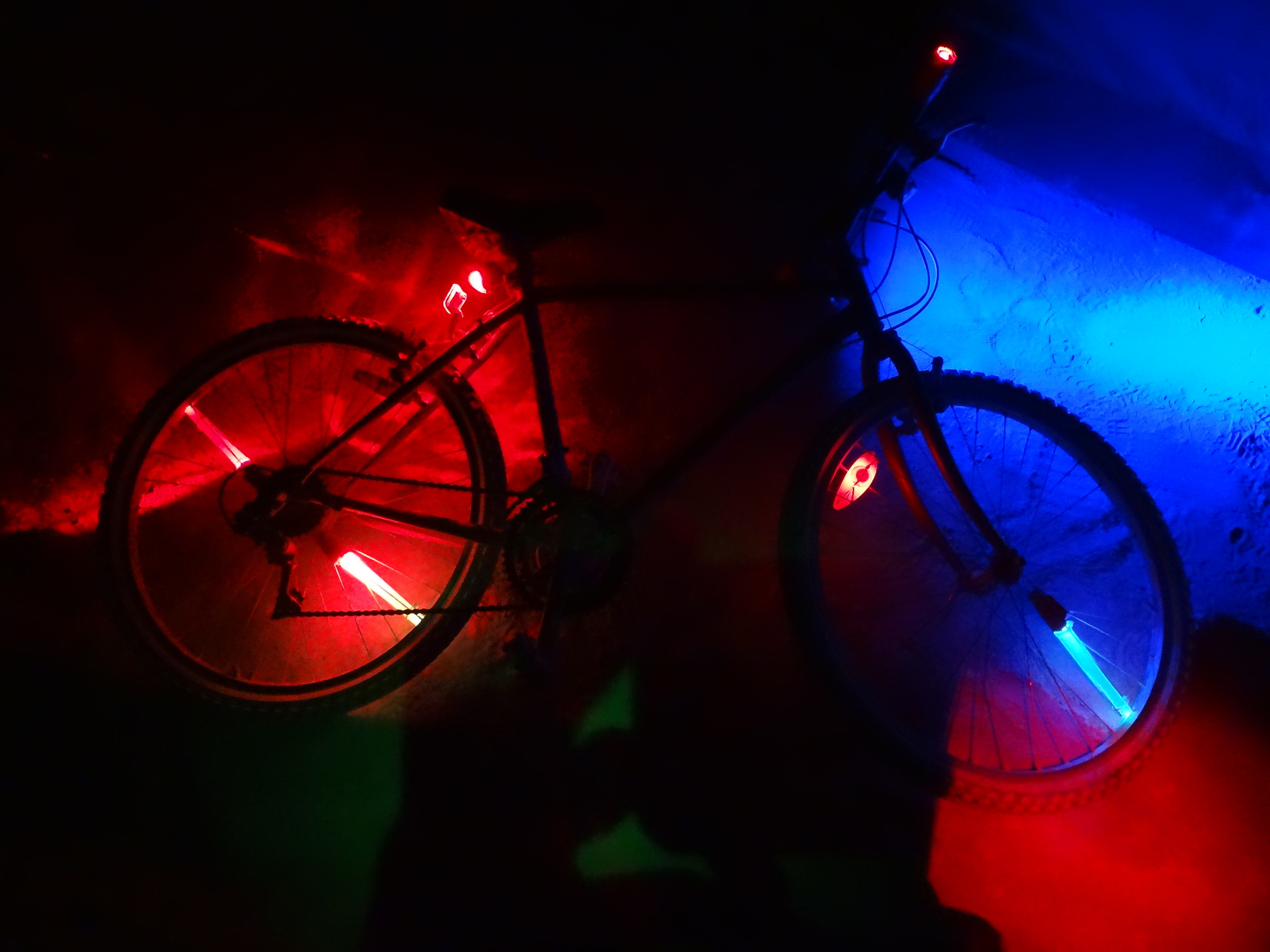 LED lights pulsate in different colors, creating interesting patterns while bikers go along in the night. Combined with my bicycle, I had fourteen individual lights attached to me, and it was nowhere near excessive.