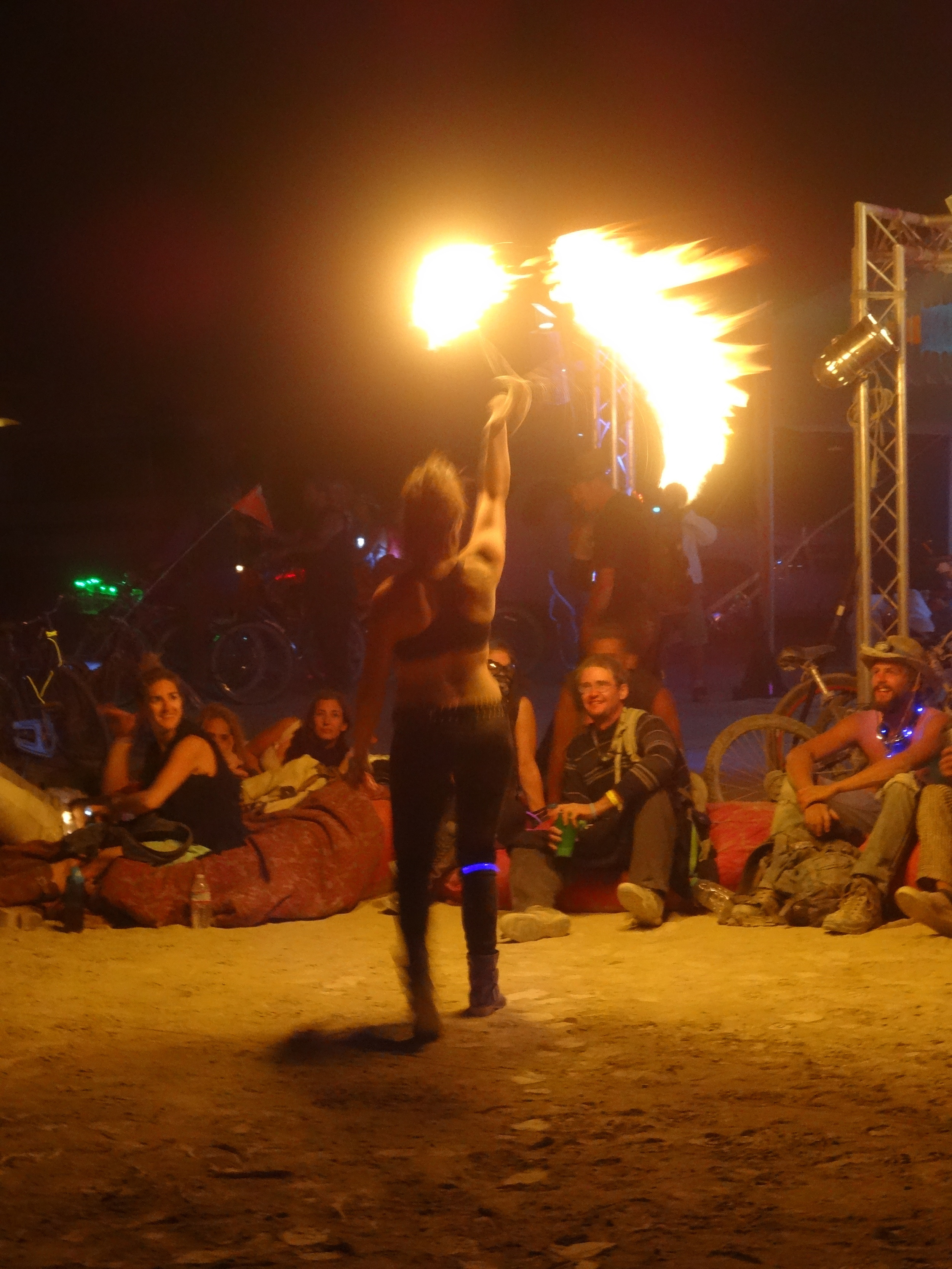 A firedancer entertains the crowd in the hour preceding the burning of the Man. There were over fifty such dancers performing choreographed moves incorporating flaming juggling balls among other tools.