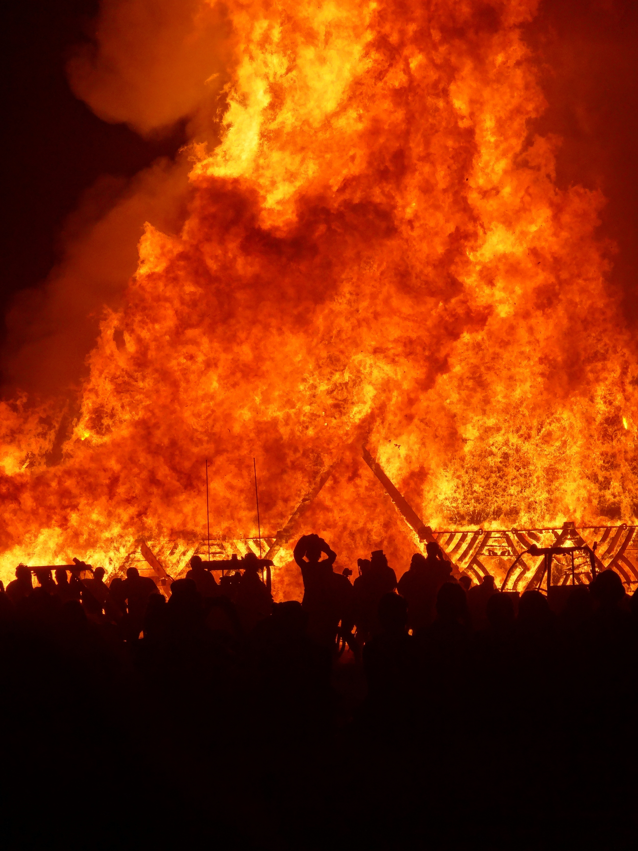 The Temple of Whollyness burns on Sunday night. The quiet ceremony features soft meditation bells, but was punctuated by one large gasp as the bulk of the pyramid shape came crashing down.