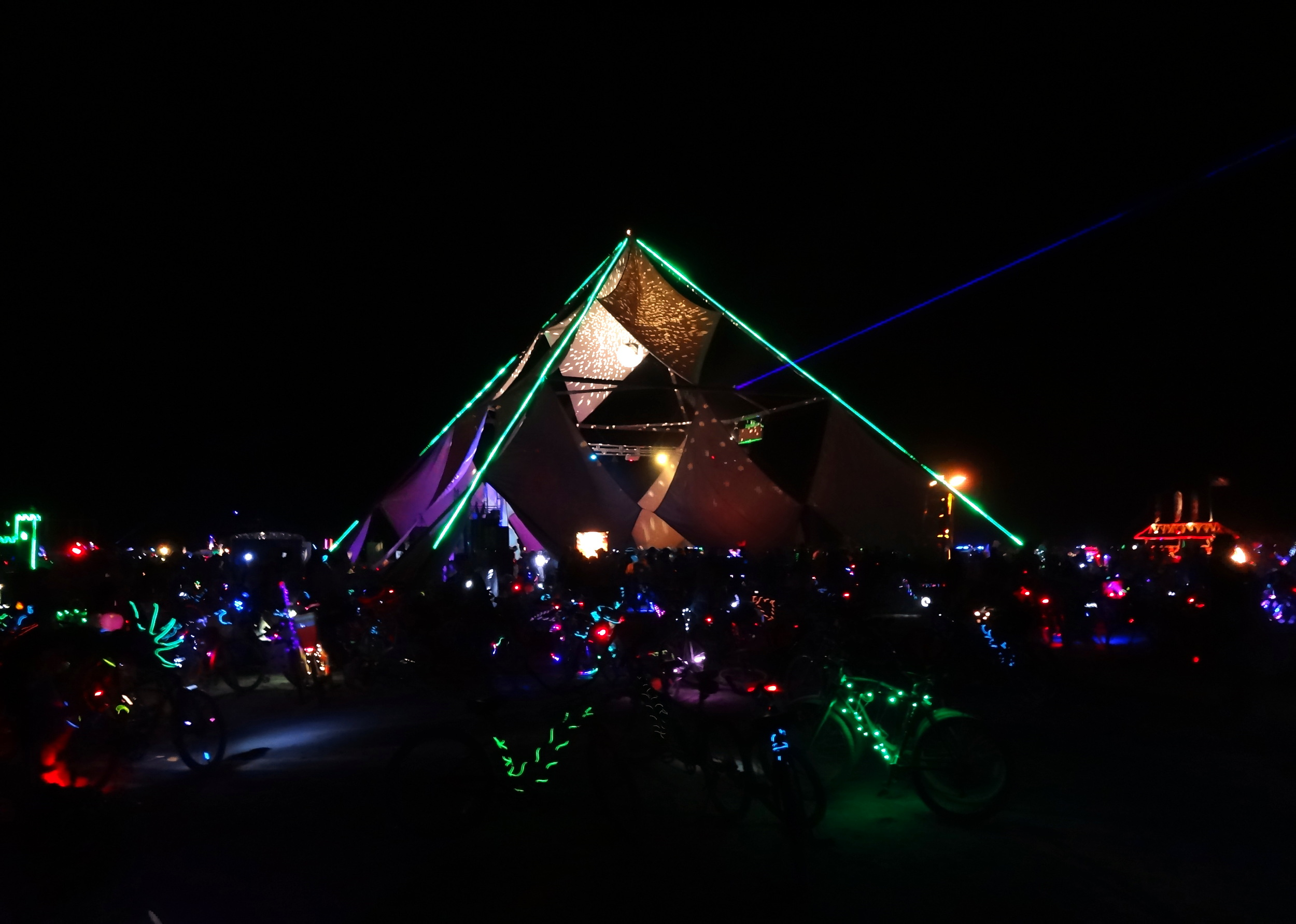 Dancers enjoy the music at Osiris, one of the largest camps. Intermittent fire would ignite from the pyramid's apex, lighting up the dancefloor like it was daytime.