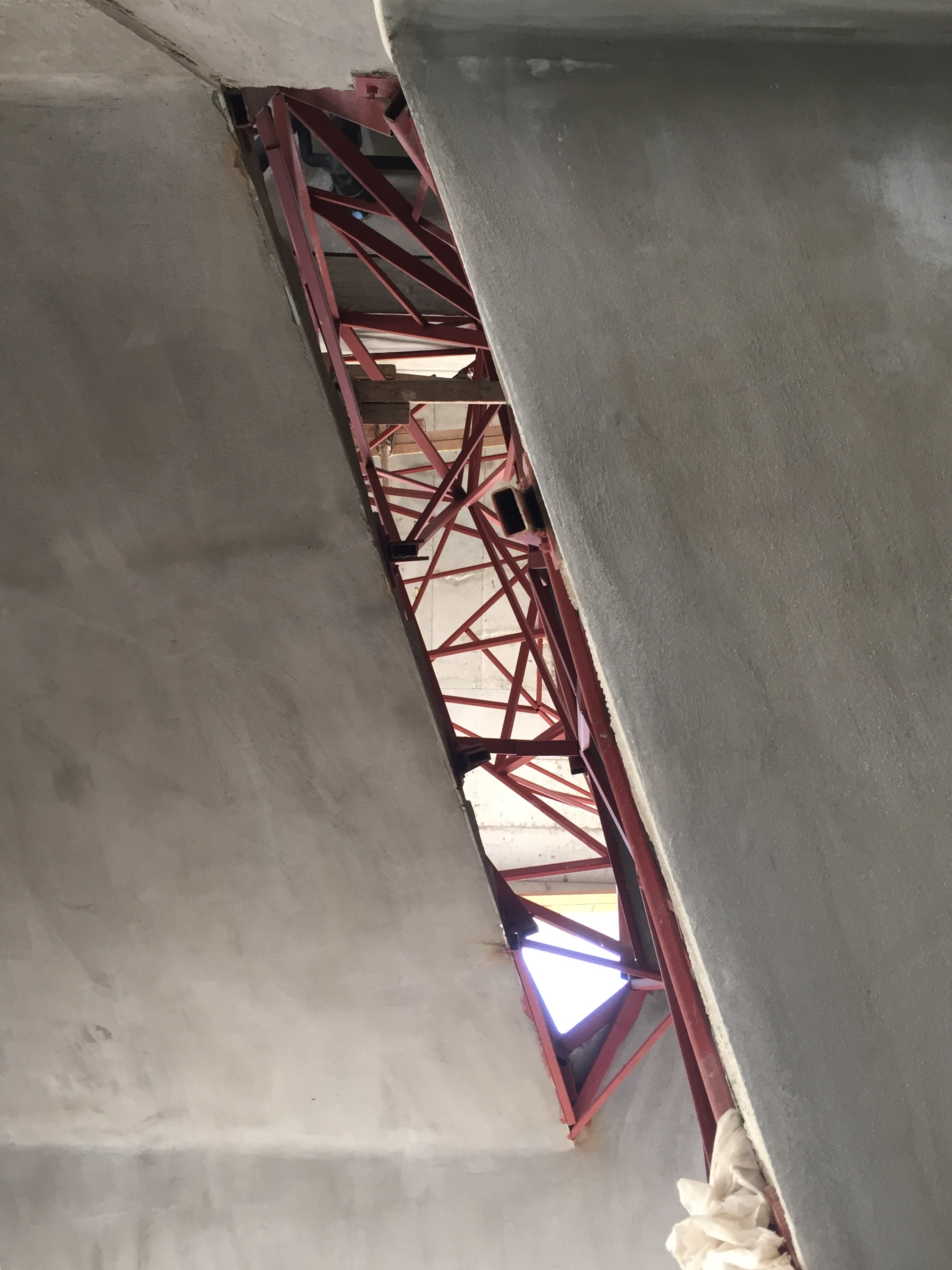 Part of the metal framing in the main stairway, to be fully cladded by wood.