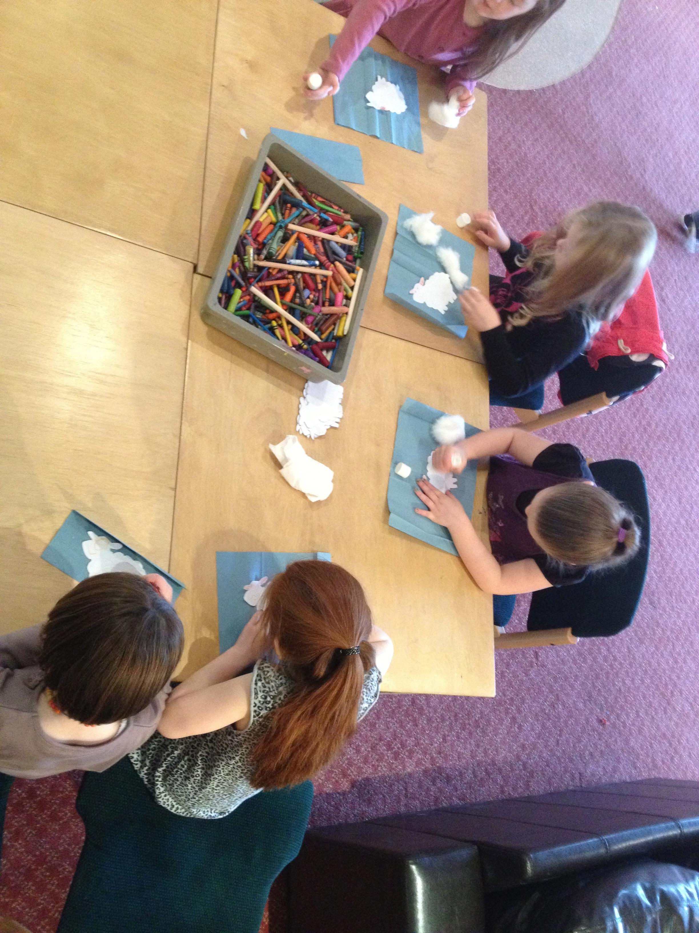 Children busy making their own little sheep at the crafts station.