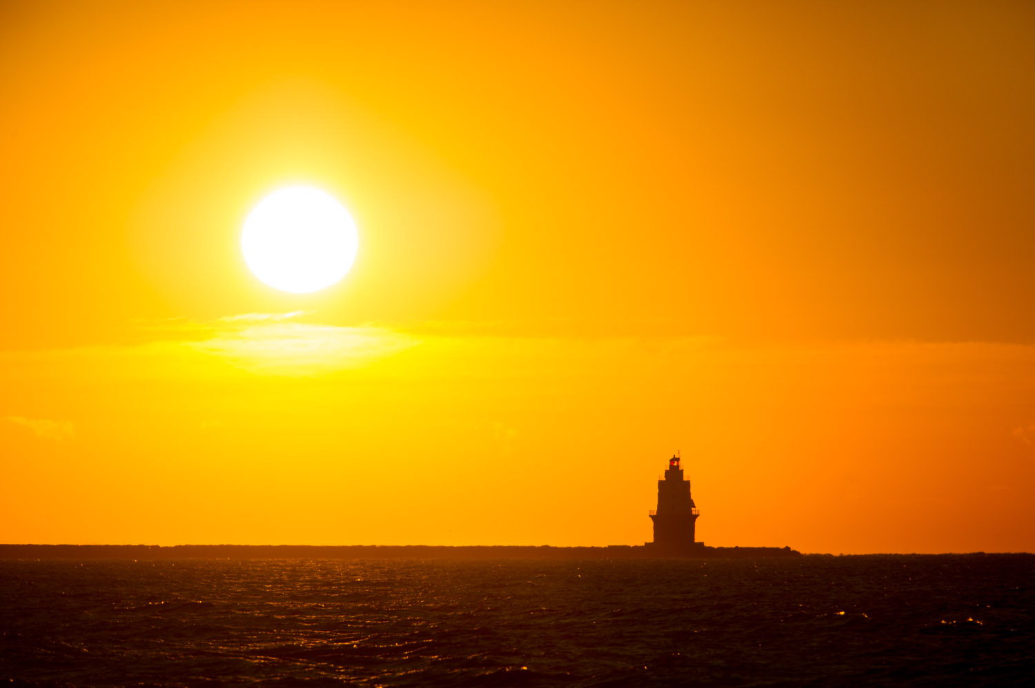 Sunrise behind the Harbor of Refuge Lighthouse as we leave Lewes Delaware in the morning.