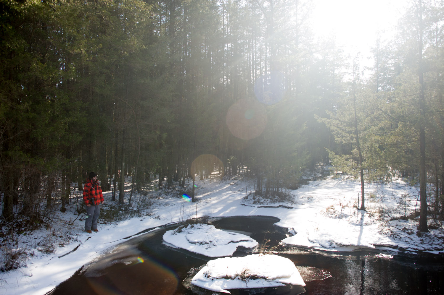 My friend Jesse standing on the edge of the icy river. Taken at Wharton State Forest in the NJ Pine Barrens.