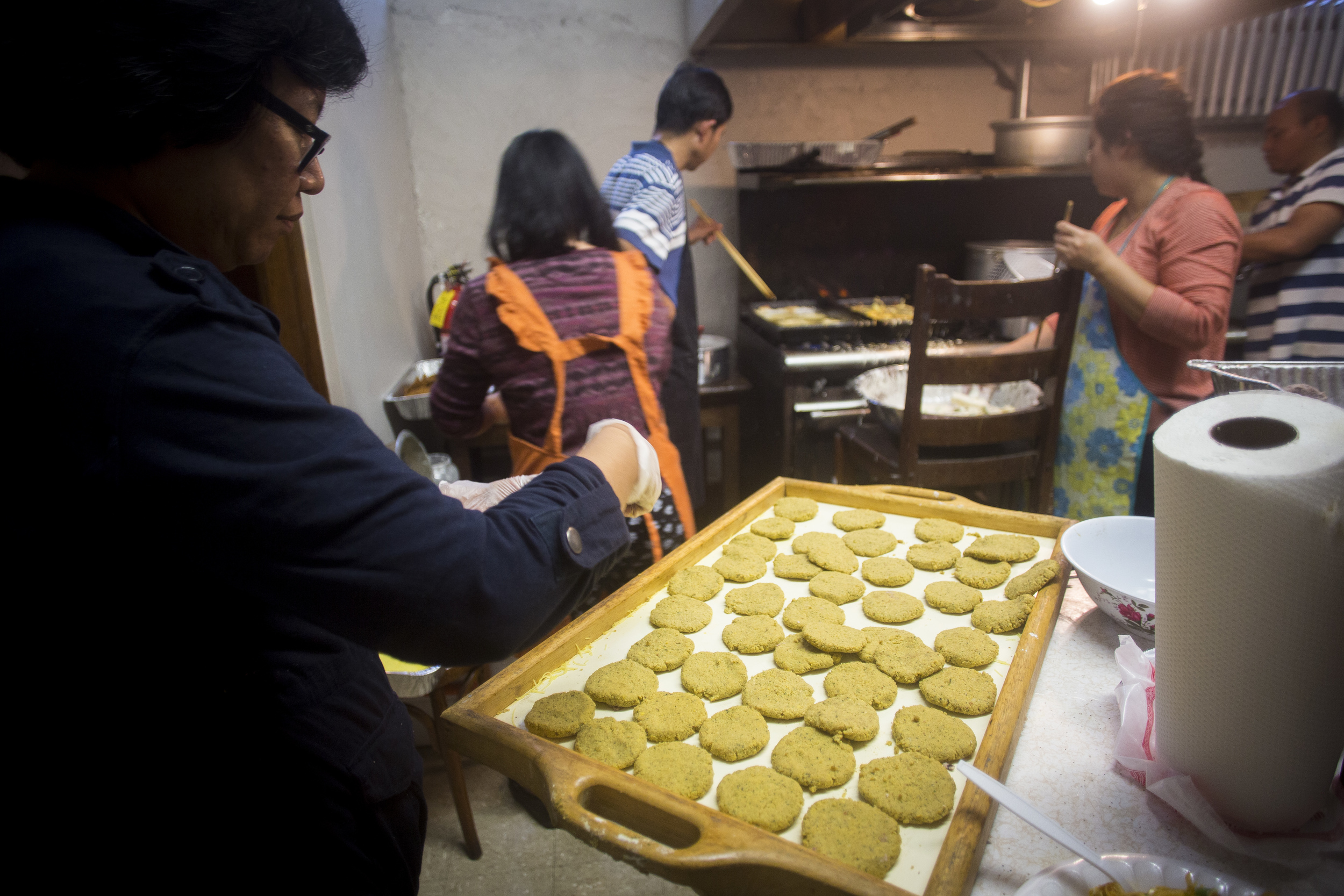 Preparing home-made authentic Burmese food at the kitchen in the basement of the International Community Church. By Ann Wang